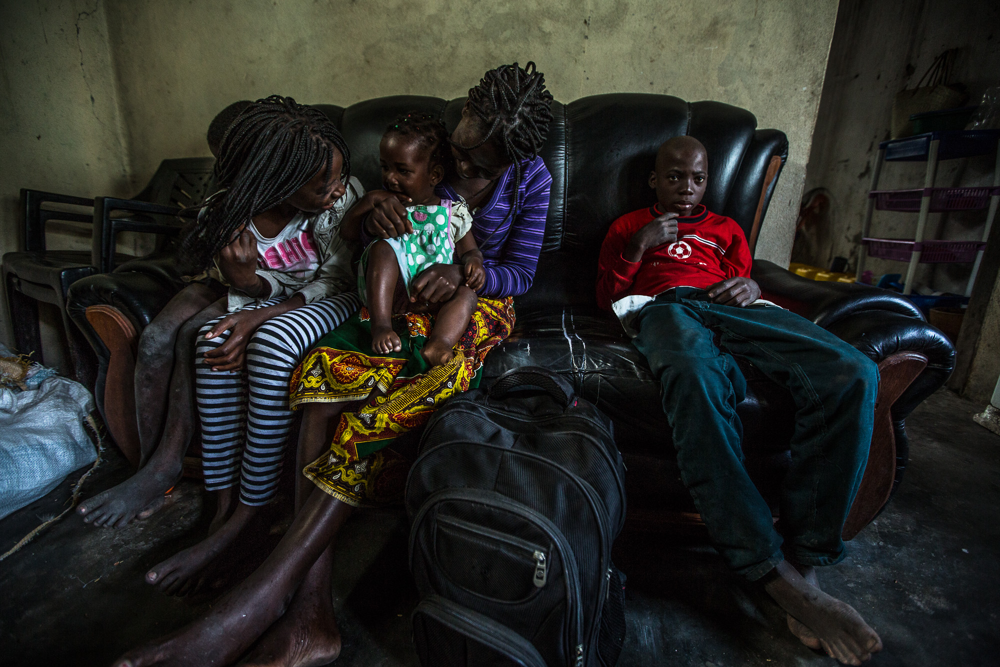 Salima spends most of her days watching TV at home with her kids.