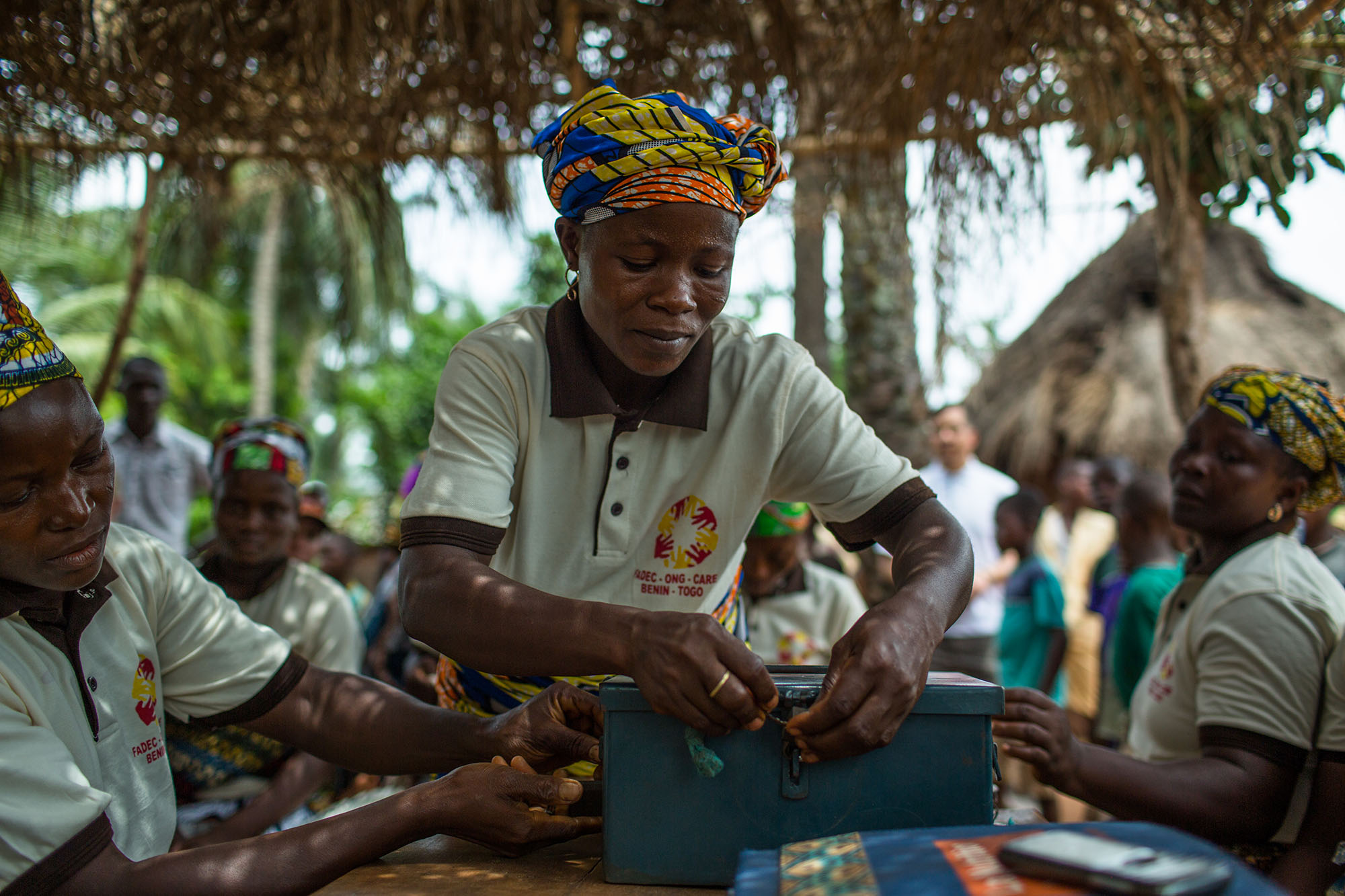 FINGNIKANME DANGBO COMMUNE, BENIN:  April 4, 2016 - CARE advocates watch as a village savings and loan group in Benin perform a mock meeting. Photo by Morgana Wingard