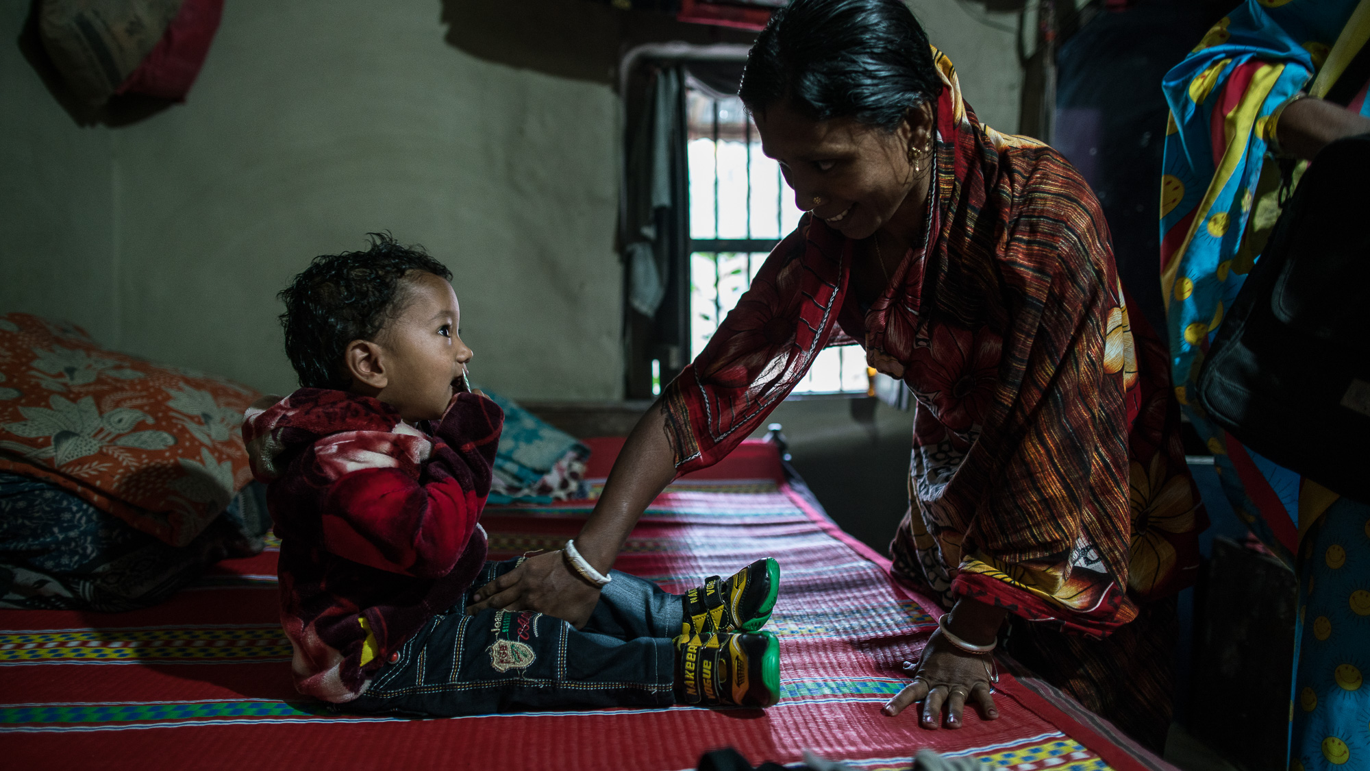 Supriya Dae (mother) and her husband, Rotonu Dey, wake up their son, Ornoy Dey in the morning