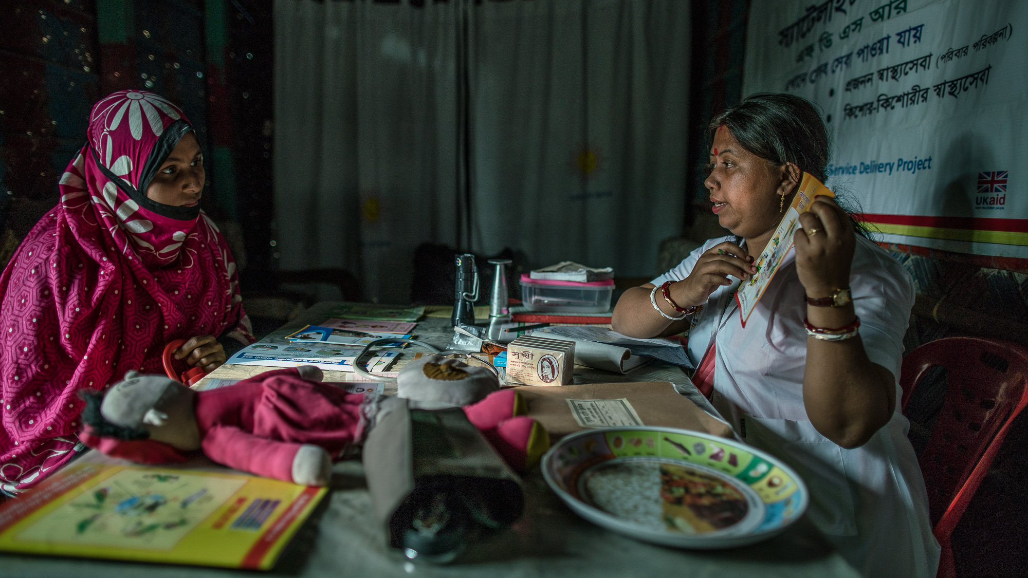 Shanta Das, a paramedic at Smiling Sun Clinic, consults pregnant mothers in a satellite clinic