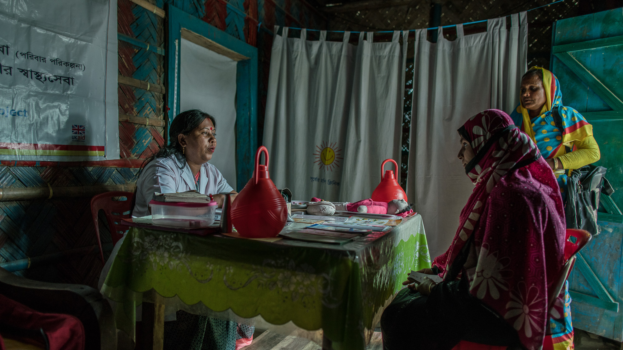 Shanta Das, a paramedic at Smiling Sun Clinic, consults pregnant mothers in a satellite clinic.