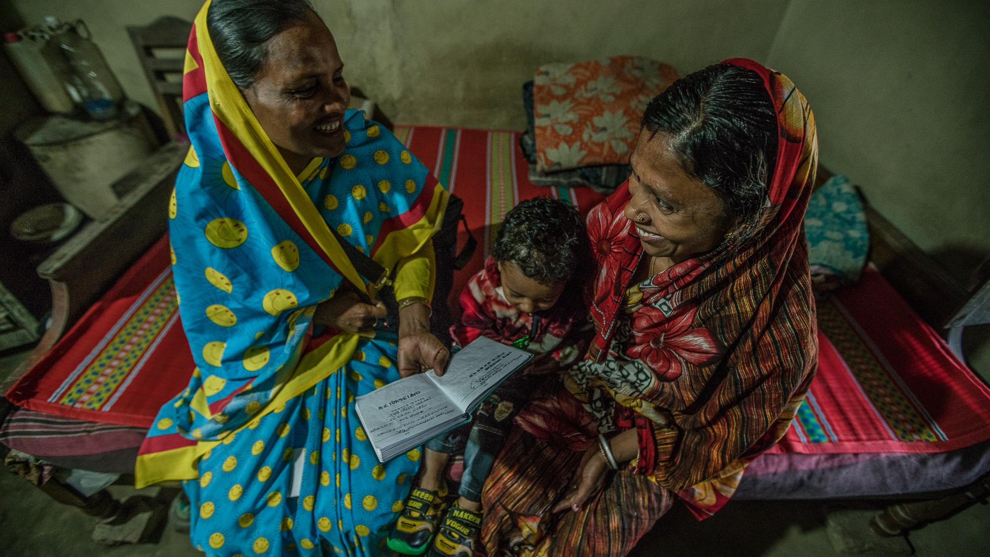 Halima Begum, a community service provider, educates Supriya Dae on child and maternal health.