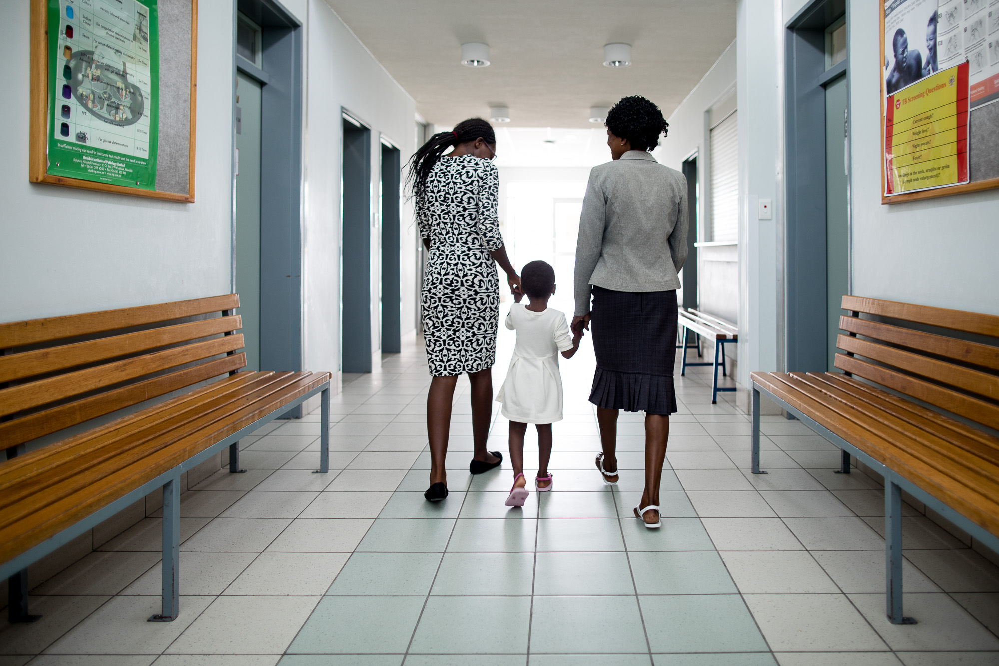 HIV patient Loide Iikuyu, 45, and two of her daughters
