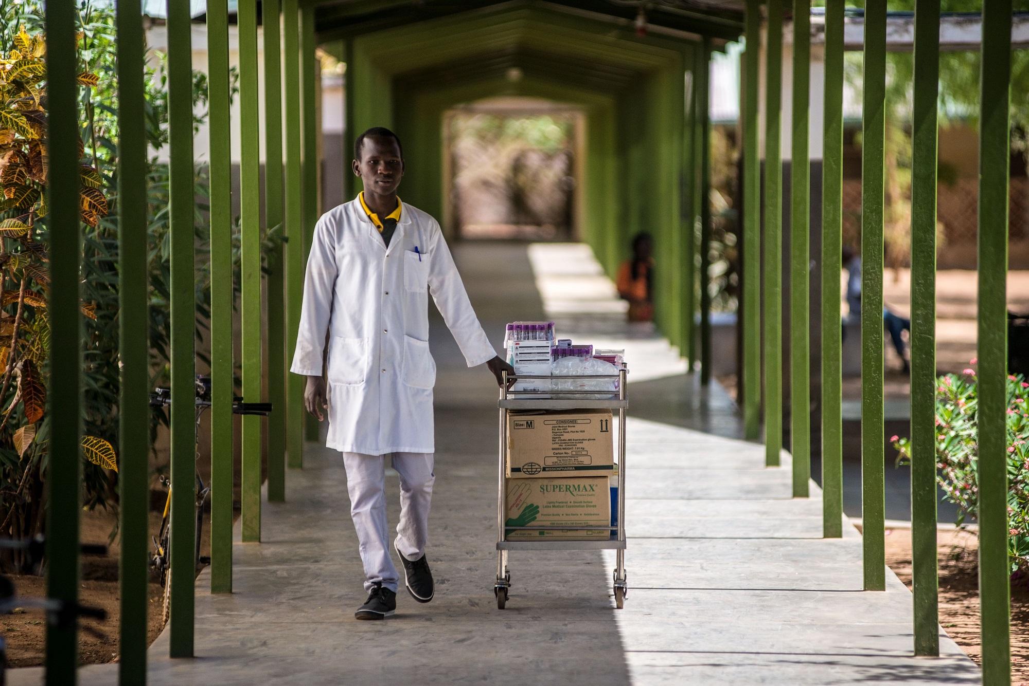 A member of staff pushes a medical trolley between wards at the Matany hospital in Karamoja, Uganda.