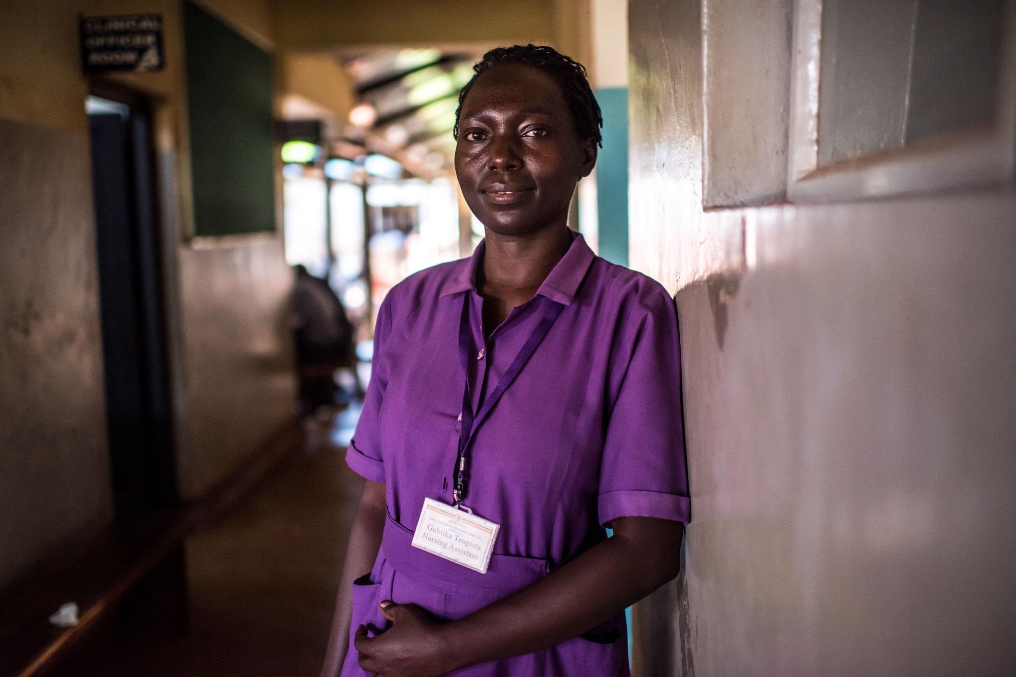 Nursing assistant Gubiika Teopista, photographed in the outpatient department of the Jinja Regional Referral Hospital in Jinja, Uganda.