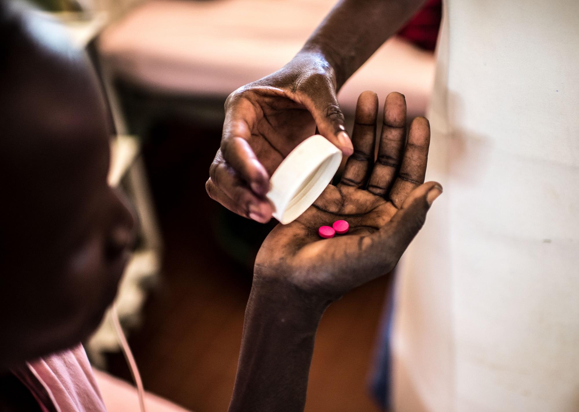 Midwife Lotukei Anna Grace dispenses a patient's medications in the maternity ward of the Matany hospital in Karamoja, Uganda.
