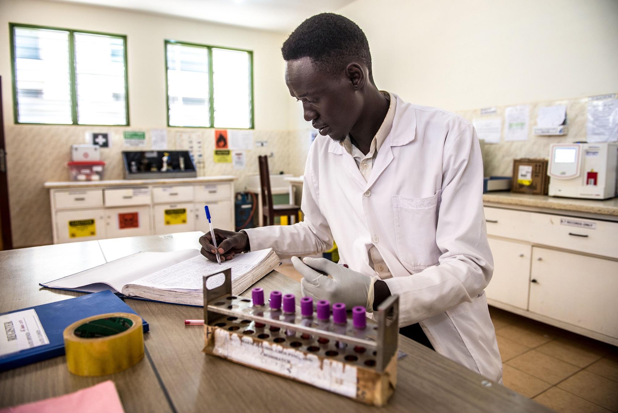 Abraham Atirak, 26, a lab assistant at the Matany hospital in Karamoja, Uganda, tests blood samples to ascertain the blood group.