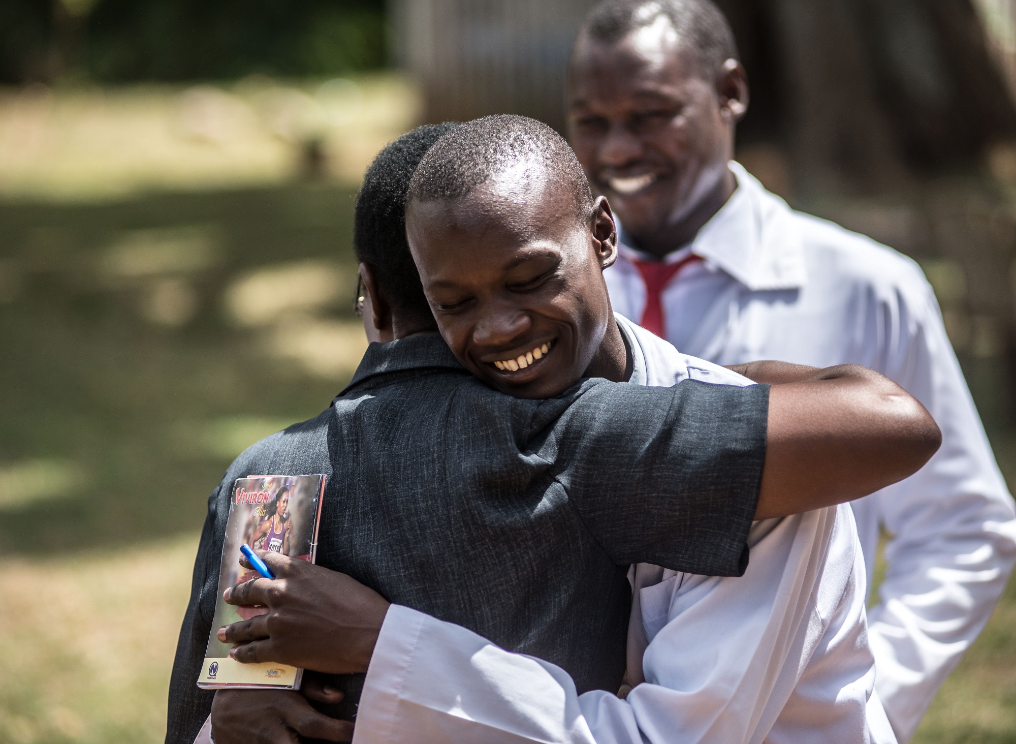 Dennis Odongo, 24, a student of the Soroti Pharmacy School, meets Christine Alura, IntraHealth Uganda Nursing and Midwifery program officer, for the first time.