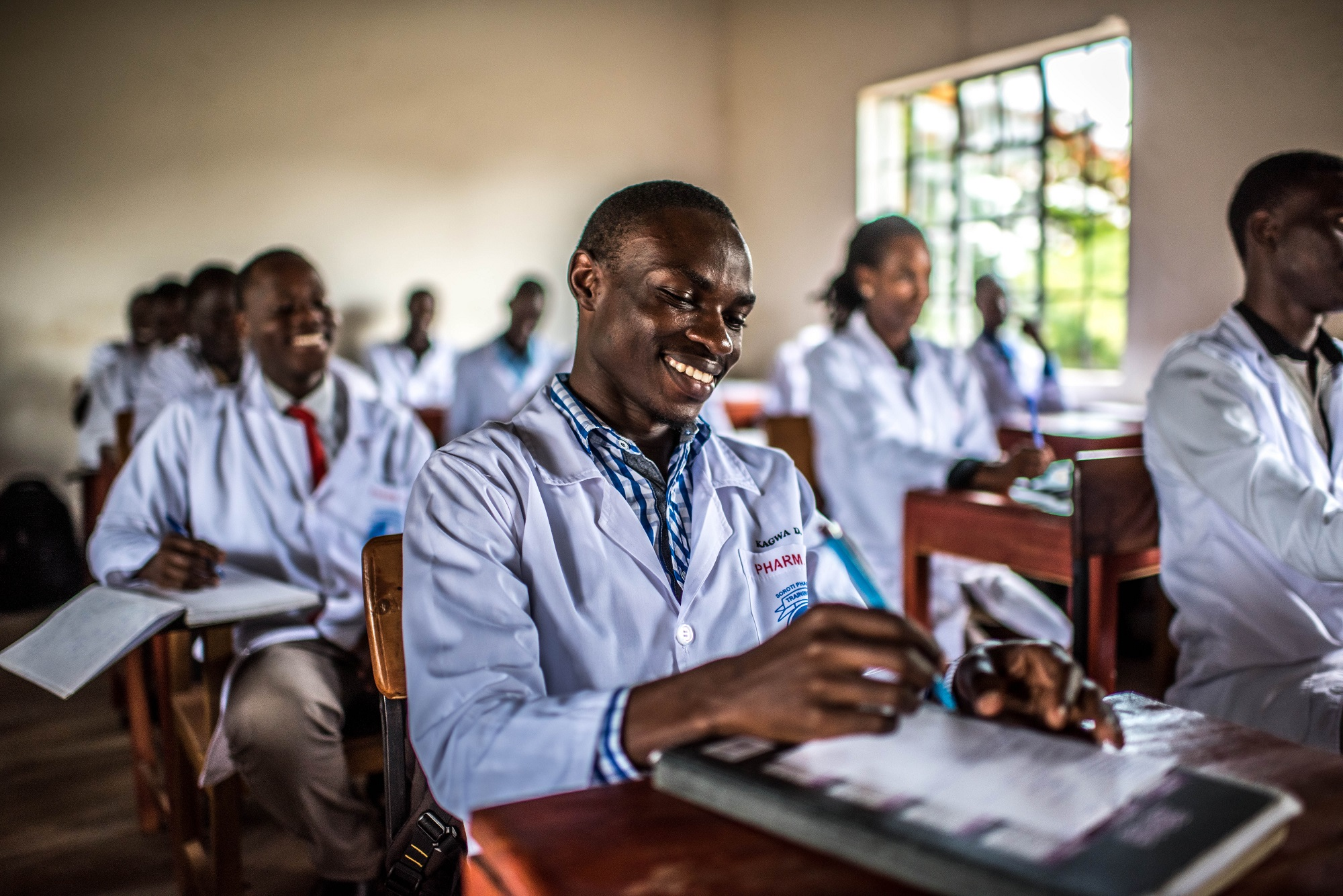 Students attend a class at the Soroti Pharmacy School.