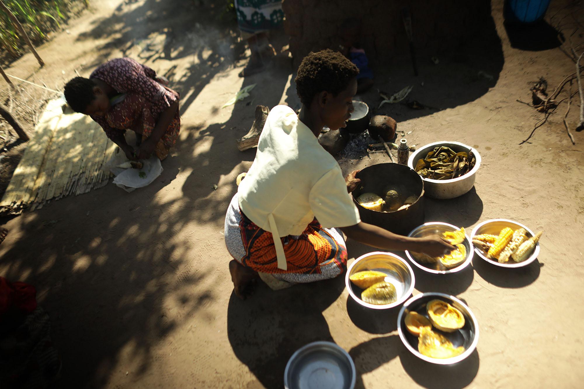 A woman prepares food near Mariam Chinguwo's house. Photo by Josh Estey