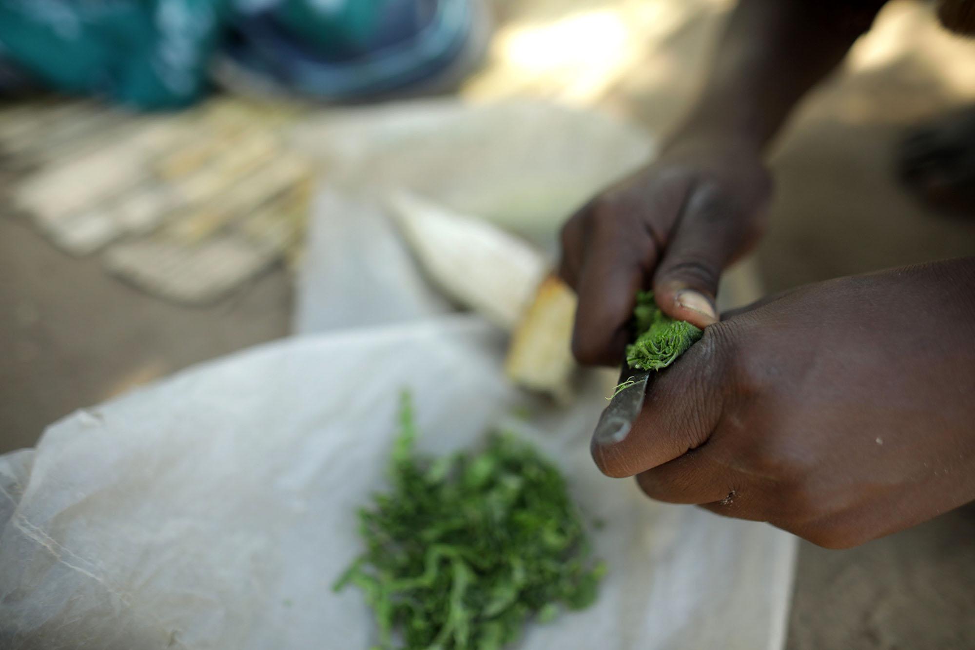 Mariam Chinguwo prepares food.Photo by Josh Estey