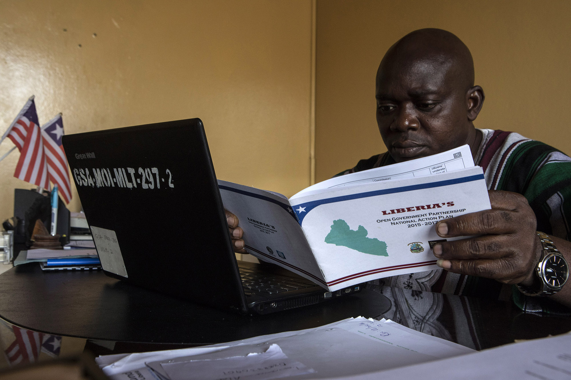 Andrew G. Temeh, Deputy Minister of Administration at the Ministry of Information (MICAT) and the OGP Focal Person, works at his desk on Tuesday, Aug. 29. Minister Temeh is working with OGP to create better transparency and accountability in the government. Liberia joined OGP in 2011.