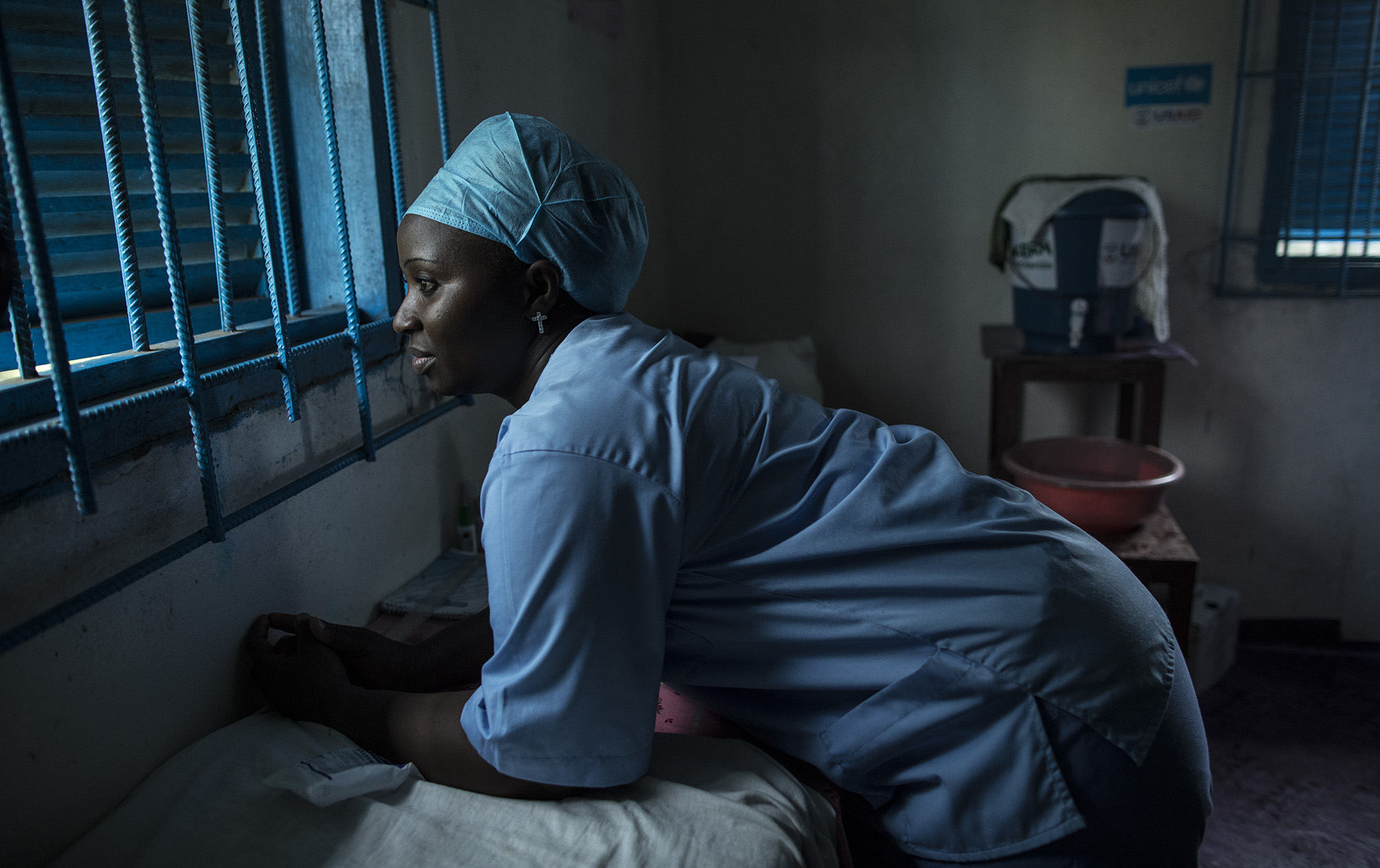 """BREWERVILLE, LIBERIA: Aug. 22, 2017 - Wislyne S. Yarh Sieh is a registered nurse and Officer in Charge (OIC) at Kpallah Community Clinic in Brewerville. Wisylne worked as a healthcare worker during the Ebola outbreak in 2014-2015. Healthcare workers like Wislyne were left isolated and alone to fight this mysterious disease from the heart of the jungle. But, she, along with many others, continued to fight. """"Being a nurse is like being a soldier. You cannot take your uniform off when there is battle. Then you are not a soldier. So I went on the frontline because I wanted to save lives,"""" she remembers. The Ministry of Health did not have a centralized system to communicate vital information to healthcare workers across the country at the same time. UNICEF and USAID worked together to create a platform that utilized mobile phones to facilitate a two way communications system between healthcare workers and the centralized ministry. Because of this new technology, healthcare workers across the country can receive text messages with important information about health emergencies. They are also able to use their phones to inform the Ministry of Health about the status of stocks in the clinic. Since Ebola, Wislyne has started using the new platform and now feels more connected and informed. She says, """"If this program just stopped without things being in place, it would carry our work backward. It would make my work longer and delay treatment of the patients."""""""