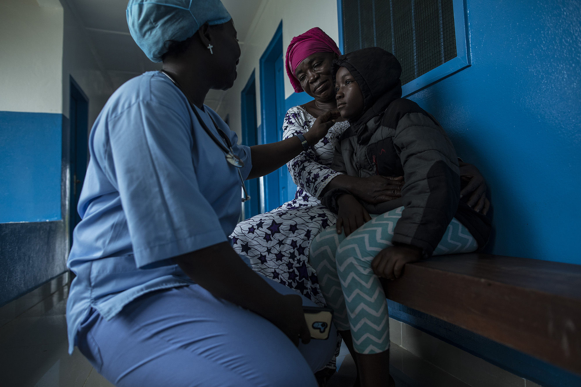 """BREWERVILLE, LIBERIA: Aug. 22, 2017 - Wislyne S. Yarh Sieh is a registered nurse and Officer in Charge (OIC) at Kpallah Community Clinic in Brewerville. Wisylne worked as a healthcare worker during the Ebola outbreak in 2014-2015. Healthcare workers like Wislyne were left isolated and alone to fight this mysterious disease from the heart of the jungle. But, she, along with many others, continued to fight. """"Being a nurse is like being a soldier. You cannot take your uniform off when there is battle. Then you are not a soldier. So I went on the frontline because I wanted to save lives,"""" she remembers. The Ministry of Health did not have a centralized system to communicate vital information to healthcare workers across the country at the same time. UNICEF and USAID worked together to create a platform that utilized mobile phones to facilitate a two way communications system between healthcare workers and the centralized ministry. Because of this new technology, healthcare workers across the country can receive text messages with important information about health emergencies. They are also able to use their phones to inform the Ministry of Health about the status of stocks in the clinic. Since Ebola, Wislyne has started using the new platform and now feels more connected and informed. She says, """"If this program just stopped without things being in place, it would carry our work backward. It would make my work longer and delay treatment of the patients."""" Photo by Sarah Grile."""