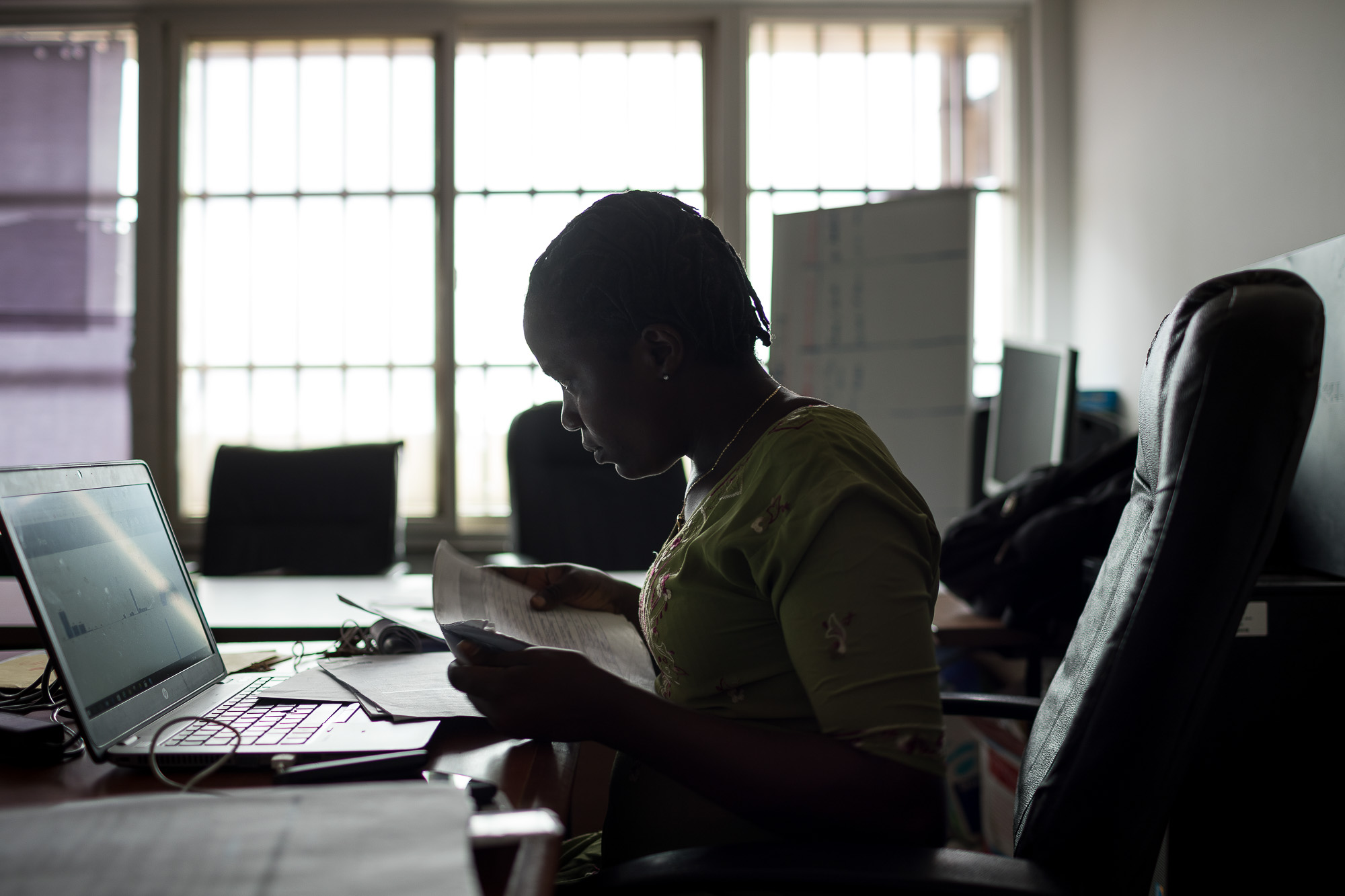 MONROVIA, LIBERIA: August 23, 2017 -  During the Ebola outbreak that started in 2014 there was no centralized system for the Ministry of Health to communicate to all healthcare workers across the country at the same time. UNICEF and USAID teamed up to create a platform that utilized mobile phones to facilitate a two way communication system between healthcare workers and the centralized ministry. Now healthcare workers receive text messages on their phones with vital information when there is a health emergency. They can also use their phones to send important information like the status of supply stocks in the clinic. Photo by Morgana Wingard