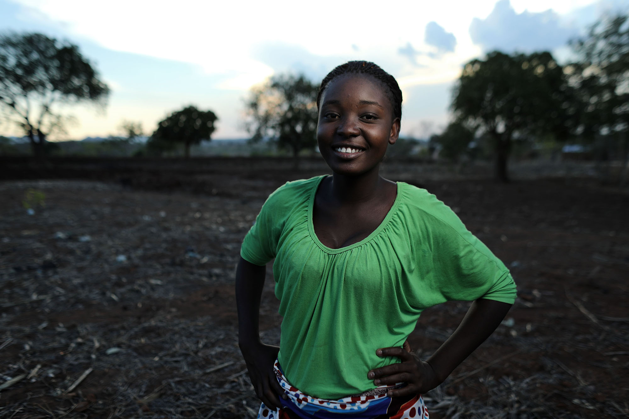 """NSANAMA, MACHINGA DISTRICT, MALAWI: Nov. 14, 2017 - The Determined, Resilient, Empowered, AIDS-free, Mentored and Safe (DREAMS) initiative is an ambitious $385 million partnership to reduce HIV infection among adolescent girls and young women (AGYW) in HIV priority areas within 10 sub-Saharan African countries that account for nearly half of the new HIV infections that occur among AGYW globally in 2014. While the main goal of the DREAMS initiative is to keep AGYW AIDS-free, the benefits of core package go well beyond the disease. DREAMS upon the USAID decades of experience empowering young women and advancing gender equality across sectors of global health, education, and economic growth, USAID partners with community, faith-based, and non-governmental organizations whose credibility within communities and capacity to mobilize significant numbers of volunteers allow USAID to address the structural inequalities impacting girls vulnerability across multiple areas. Maggie Medison, 18, who lives in Malawi, dropped out of school in 2015 because she became pregnant. In 2015, Maggie was recruited into One Community's Go Girls! Club. She later applied to be a Community Resource Person (CRP) to supervise the club. She has now become an active peer educator, a choice that has changed the course of her life. Maggie works with girls in her community to raise awareness about the importance of remaining in school and protecting ones self against HIV.""""After I fell pregnant and had my baby I thought that was the end of me. I didn't think I could do anything else in my life. But after joining the DREAMS program, I went back to school. And now I know that I can achieve whatever I want in my life."""" Maggie has both a bright outlook on her future and a realistic approach to life. She says, """"I want to be a role model for my daughter to follow."""" Photo by Josh Estey."""