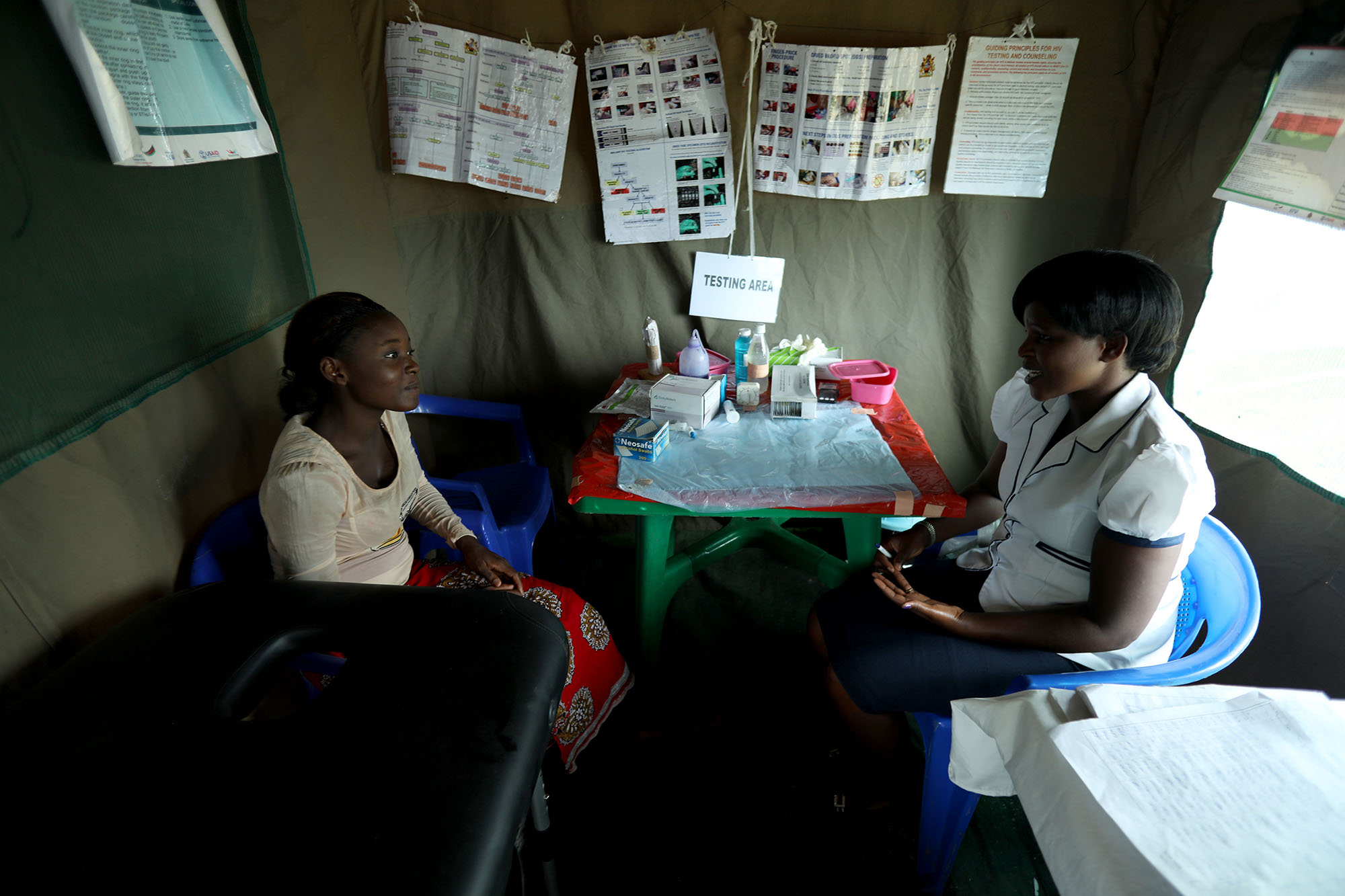"""NSANAMA, MACHINGA DISTRICT, MALAWI: Nov. 15, 2017 - The Determined, Resilient, Empowered, AIDS-free, Mentored and Safe (DREAMS) initiative is an ambitious $385 million partnership to reduce HIV infection among adolescent girls and young women (AGYW) in HIV priority areas within 10 sub-Saharan African countries that account for nearly half of the new HIV infections that occur among AGYW globally in 2014. While the main goal of the DREAMS initiative is to keep AGYW AIDS-free, the benefits of core package go well beyond the disease. DREAMS upon the USAID decades of experience empowering young women and advancing gender equality across sectors of global health, education, and economic growth, USAID partners with community, faith-based, and non-governmental organizations whose credibility within communities and capacity to mobilize significant numbers of volunteers allow USAID to address the structural inequalities impacting girls vulnerability across multiple areas. Maggie Medison, 18, who lives in Malawi, dropped out of school in 2015 because she became pregnant. In 2015, Maggie was recruited into One Community's Go Girls! Club. She later applied to be a Community Resource Person (CRP) to supervise the club. She has now become an active peer educator, a choice that has changed the course of her life. Maggie works with girls in her community to raise awareness about the importance of remaining in school and protecting ones self against HIV.""""After I fell pregnant and had my baby I thought that was the end of me. I didn't think I could do anything else in my life. But after joining the DREAMS program, I went back to school. And now I know that I can achieve whatever I want in my life."""" Maggie has both a bright outlook on her future and a realistic approach to life. She says, """"I want to be a role model for my daughter to follow."""" Photo by Josh Estey."""