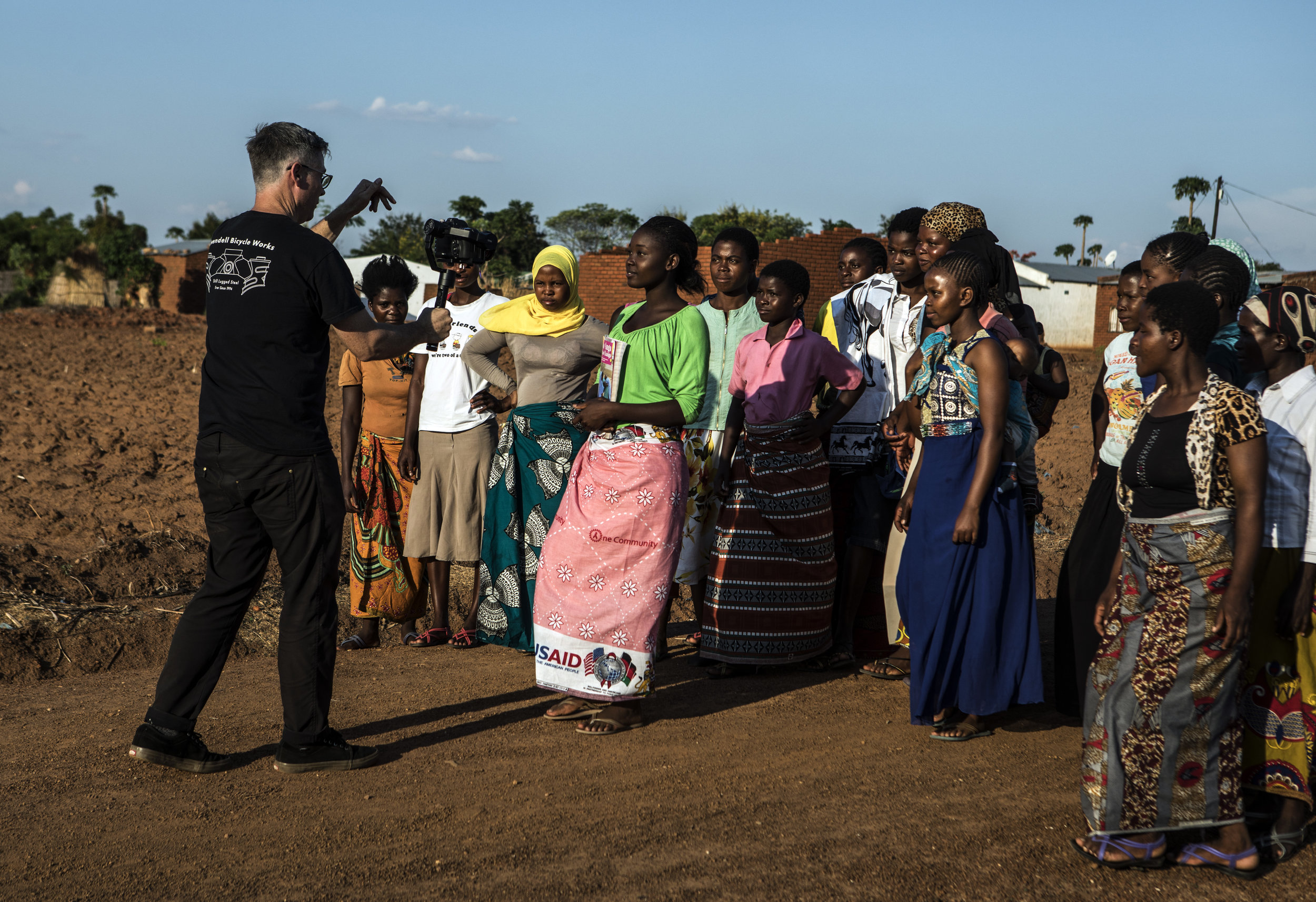 """NSANAMA, MACHINGA DISTRICT, MALAWI: Nov. 14, 2017 - The Determined, Resilient, Empowered, AIDS-free, Mentored and Safe (DREAMS) initiative is an ambitious $385 million partnership to reduce HIV infection among adolescent girls and young women (AGYW) in HIV priority areas within 10 sub-Saharan African countries that account for nearly half of the new HIV infections that occur among AGYW globally in 2014. While the main goal of the DREAMS initiative is to keep AGYW AIDS-free, the benefits of core package go well beyond the disease. DREAMS upon the USAID decades of experience empowering young women and advancing gender equality across sectors of global health, education, and economic growth, USAID partners with community, faith-based, and non-governmental organizations whose credibility within communities and capacity to mobilize significant numbers of volunteers allow USAID to address the structural inequalities impacting girls vulnerability across multiple areas. Maggie Medison, 18, who lives in Malawi, dropped out of school in 2015 because she became pregnant. In 2015, Maggie was recruited into One Community's Go Girls! Club. She later applied to be a Community Resource Person (CRP) to supervise the club. She has now become an active peer educator, a choice that has changed the course of her life. Maggie works with girls in her community to raise awareness about the importance of remaining in school and protecting ones self against HIV.""""After I fell pregnant and had my baby I thought that was the end of me. I didn't think I could do anything else in my life. But after joining the DREAMS program, I went back to school. And now I know that I can achieve whatever I want in my life."""" Maggie has both a bright outlook on her future and a realistic approach to life. She says, """"I want to be a role model for my daughter to follow."""" Photo by Sarah Grile."""