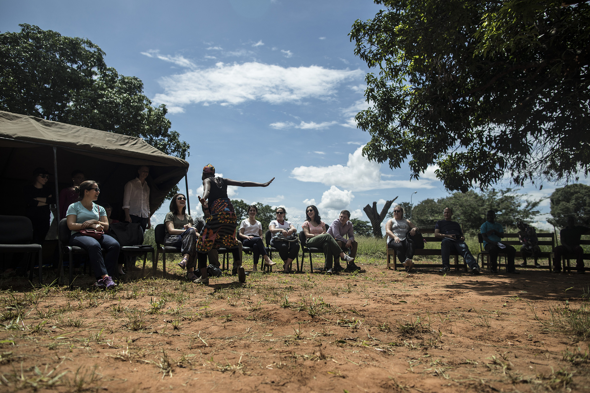 LIVINGSTONE, ZAMBIA: Feb. 20, 2018 - Members of the CARE Learning Tour to Zambia watch a dance presentation while visiting the One-Stop GBV Center in Livingstone. Photo by Sarah Grile.