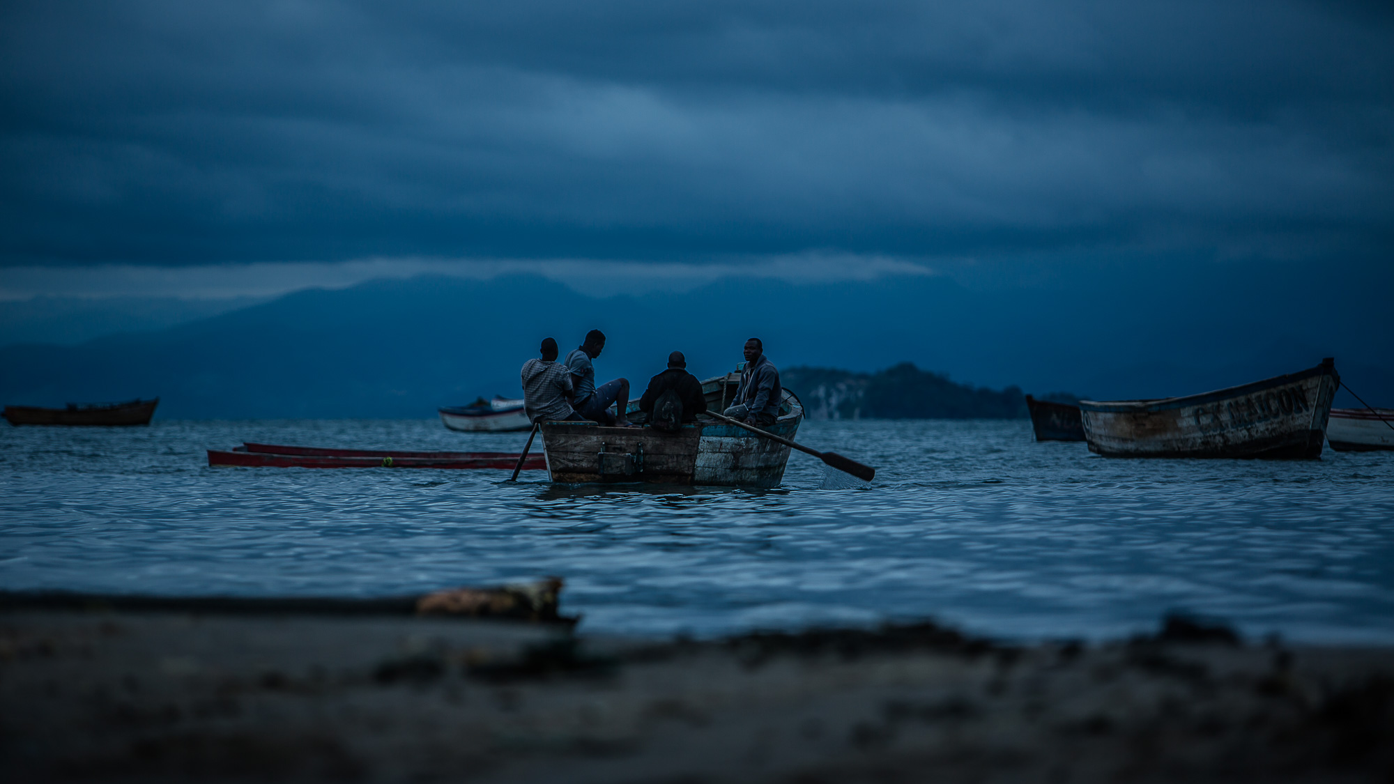 Fisherman approaching the shores of lake Malawi after the nights