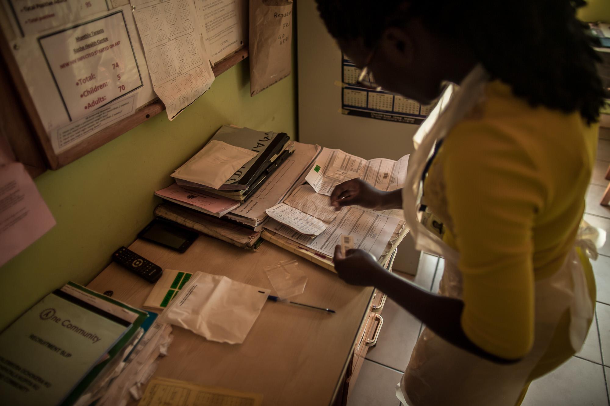 Linda Mvula updating patients records