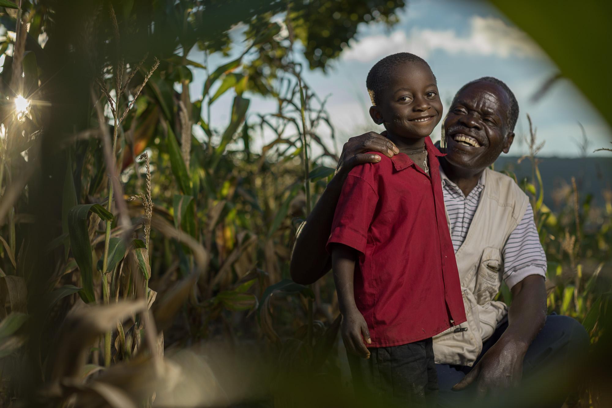 Malawian farmer Daniel Mhoni, 68, with his grandson