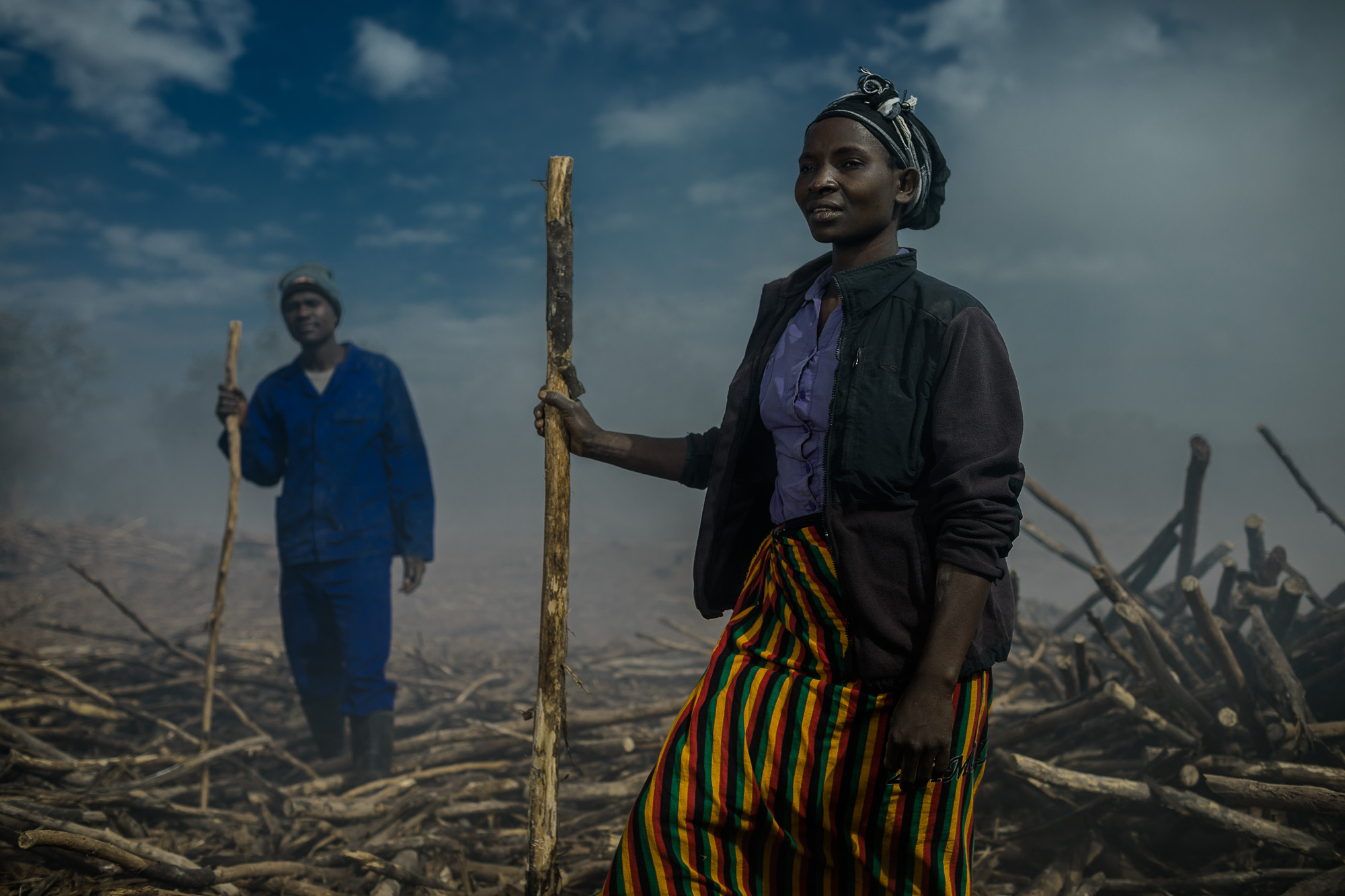 Nancy Chirwa helps to make charcoal from the Corymbia citriodora