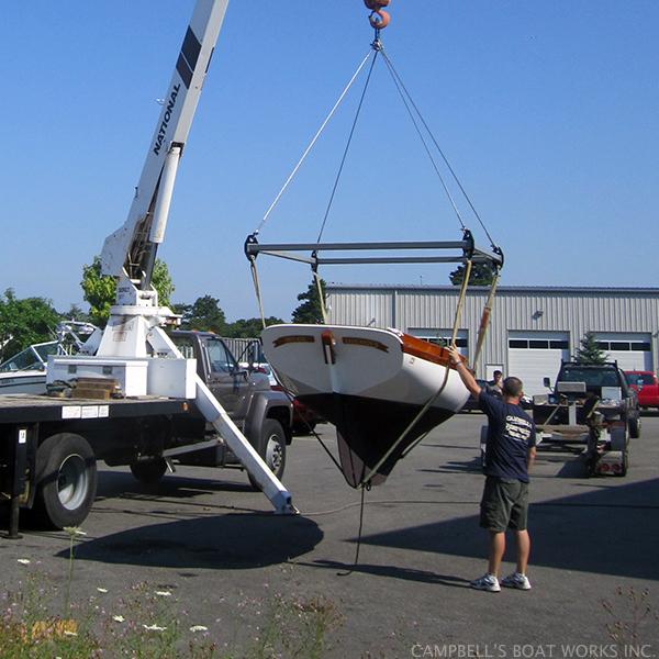 Crane Truck Loading a Doughdish onto Hydraulic Trailer, Bourne C