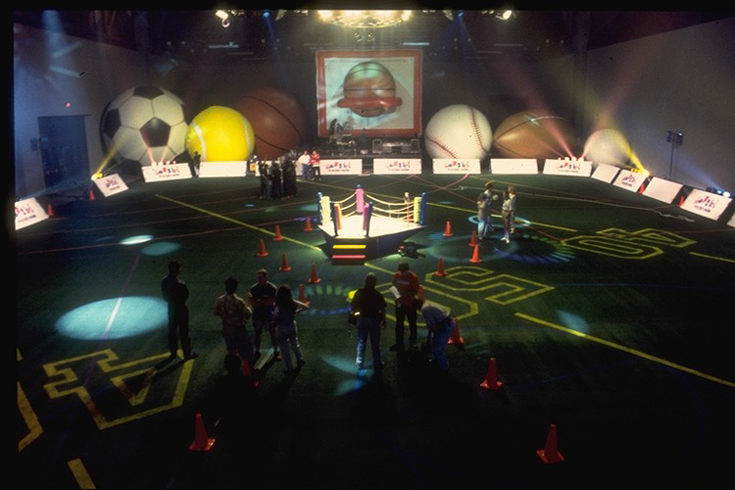 Healthsouth Launch Event -  Inflatable set pieces, Astroturf flooring & eccentric 'boxing ring' stage in centre.