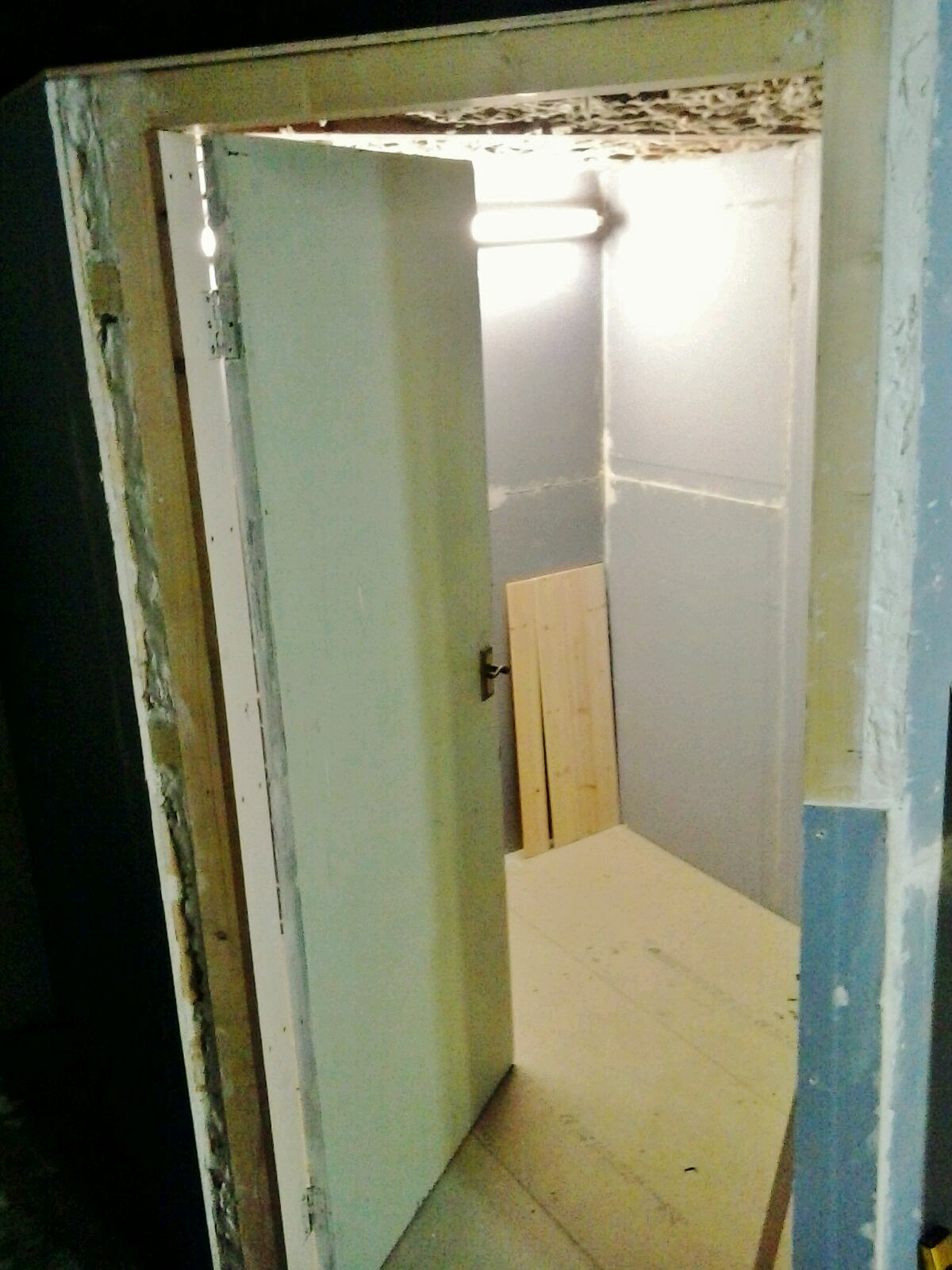 3 of 8:  Vocal booth door is fitted.