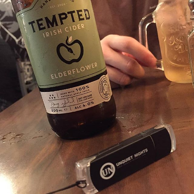 "One of these is a delicious elderflower cider brewed in Lisburn by @temptedcider which complemented an amazing meal in #darcysbelfast ...The other is the Unquiet Nights flashdrive on which you can get all our releases in one place. Both albums & all singles including ""Four Winds"" which is currently a @hotpressmagazine track of the fortnight. #music #release #single #album #usb #belfast #temptedcider #rock #alternative #shameless #selfpromotion #elderflower #restaurant"