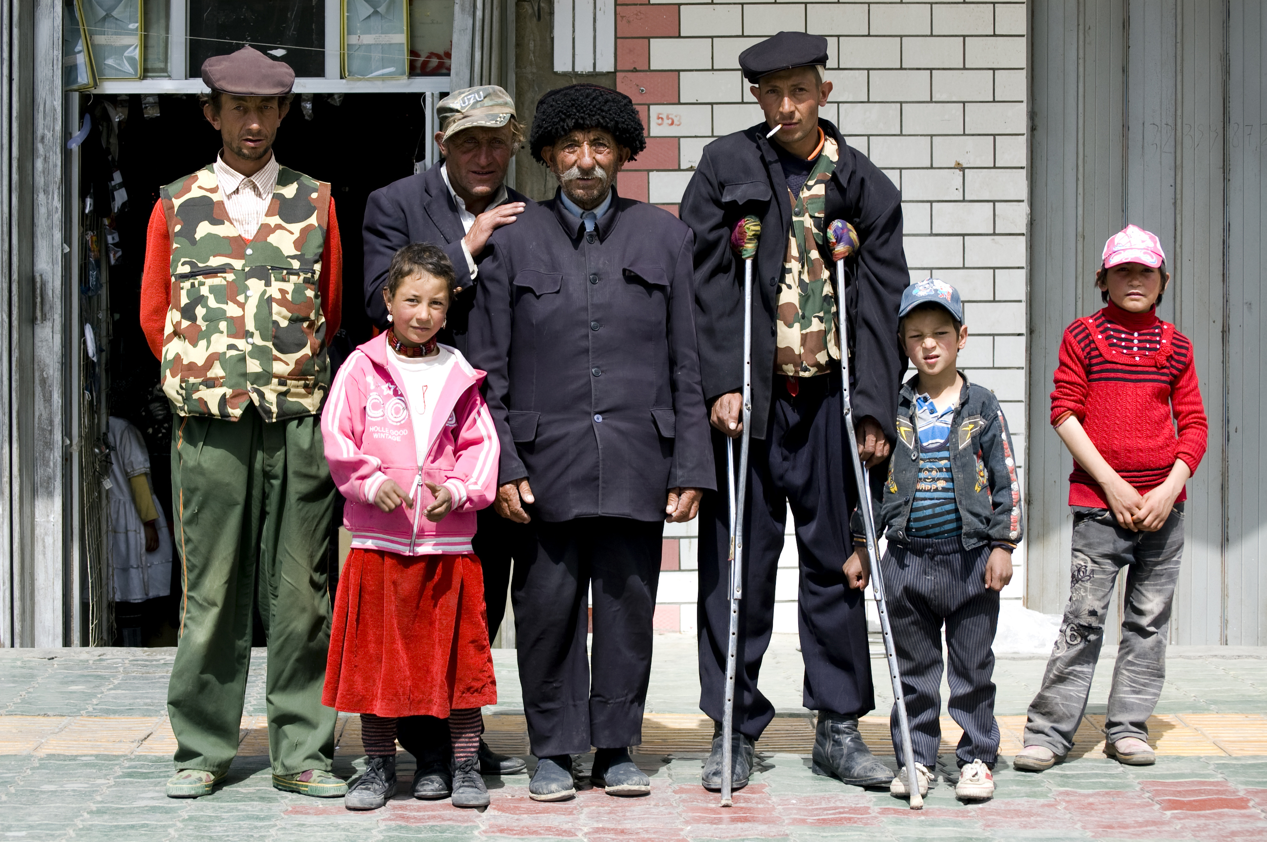 A family happy to pose in Tashkurgan