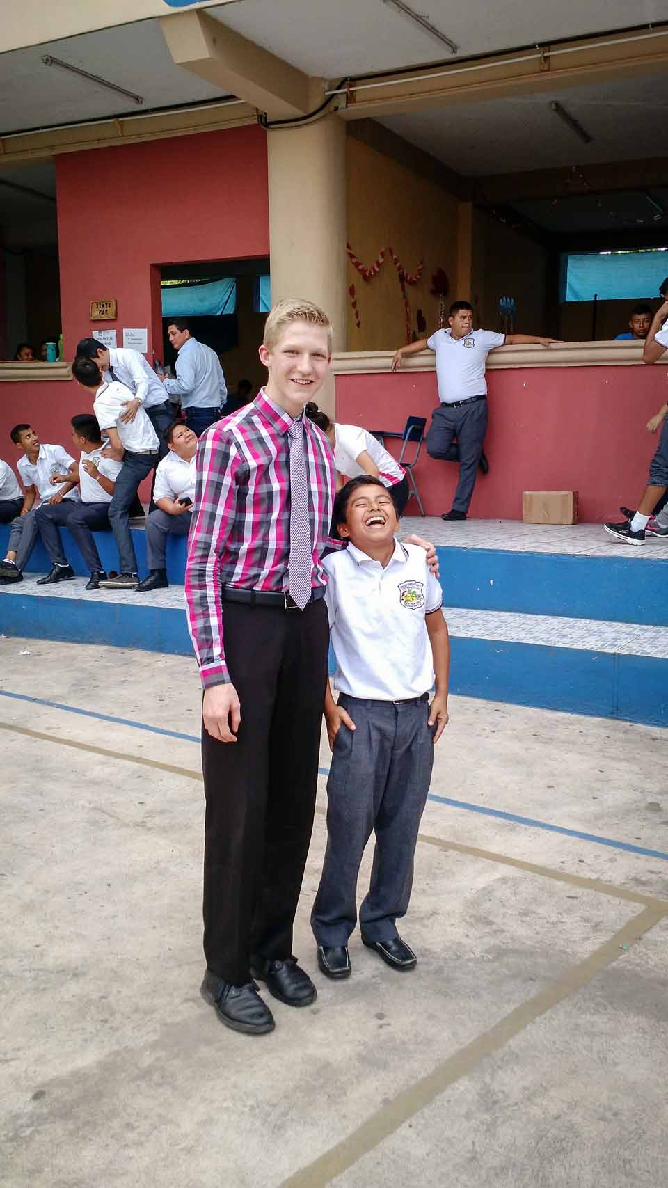 Silas and a new friend after our concert at this boy's school.