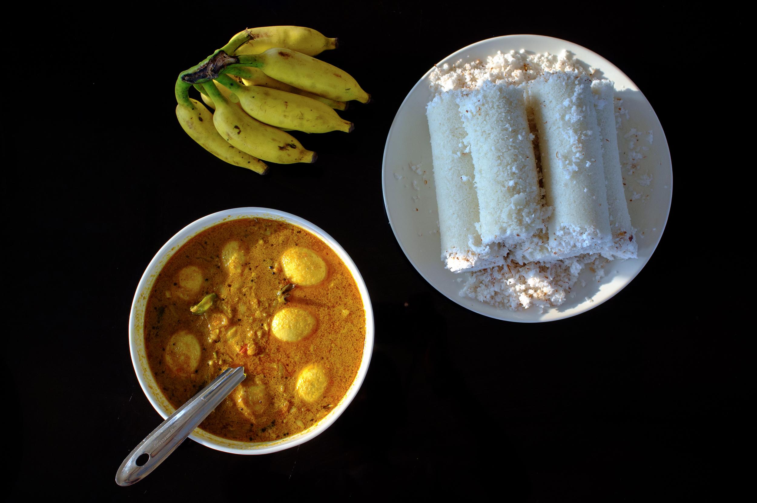 Puttu  and egg masala for breakfast on a houseboat in Alappuzha, Kerala