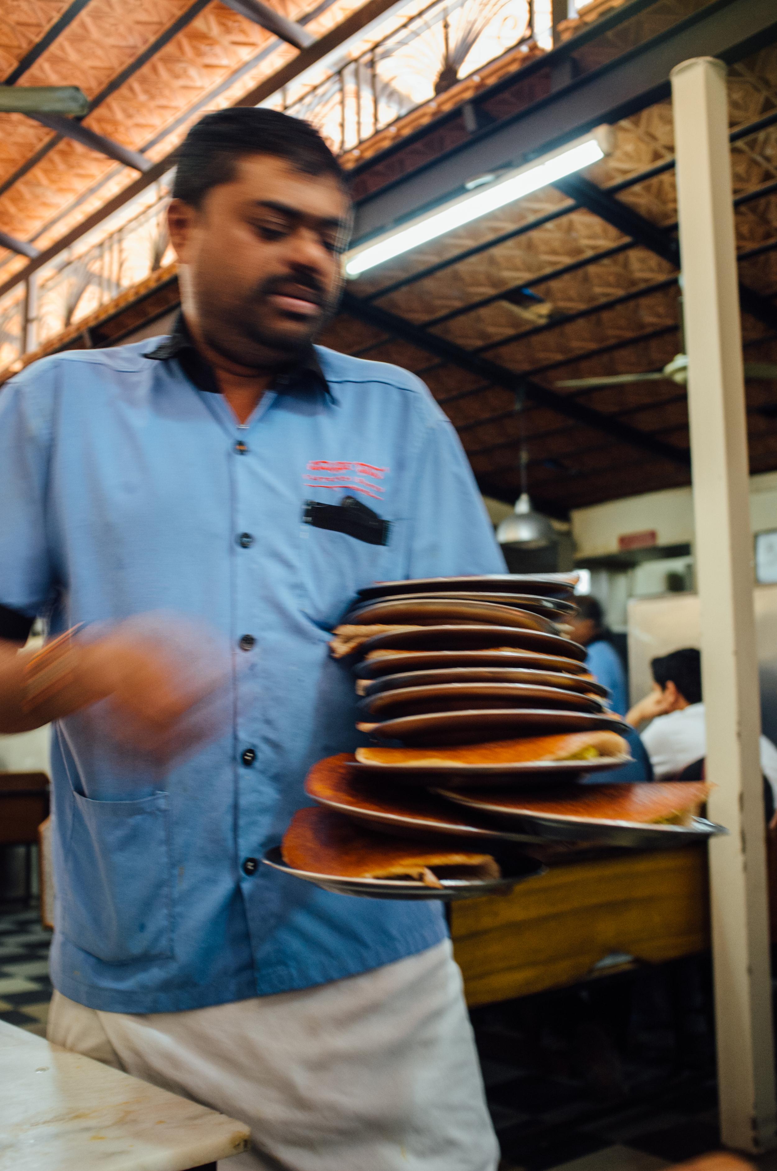 Serving up  masala dosas  at  Vidyarthi Bhavan