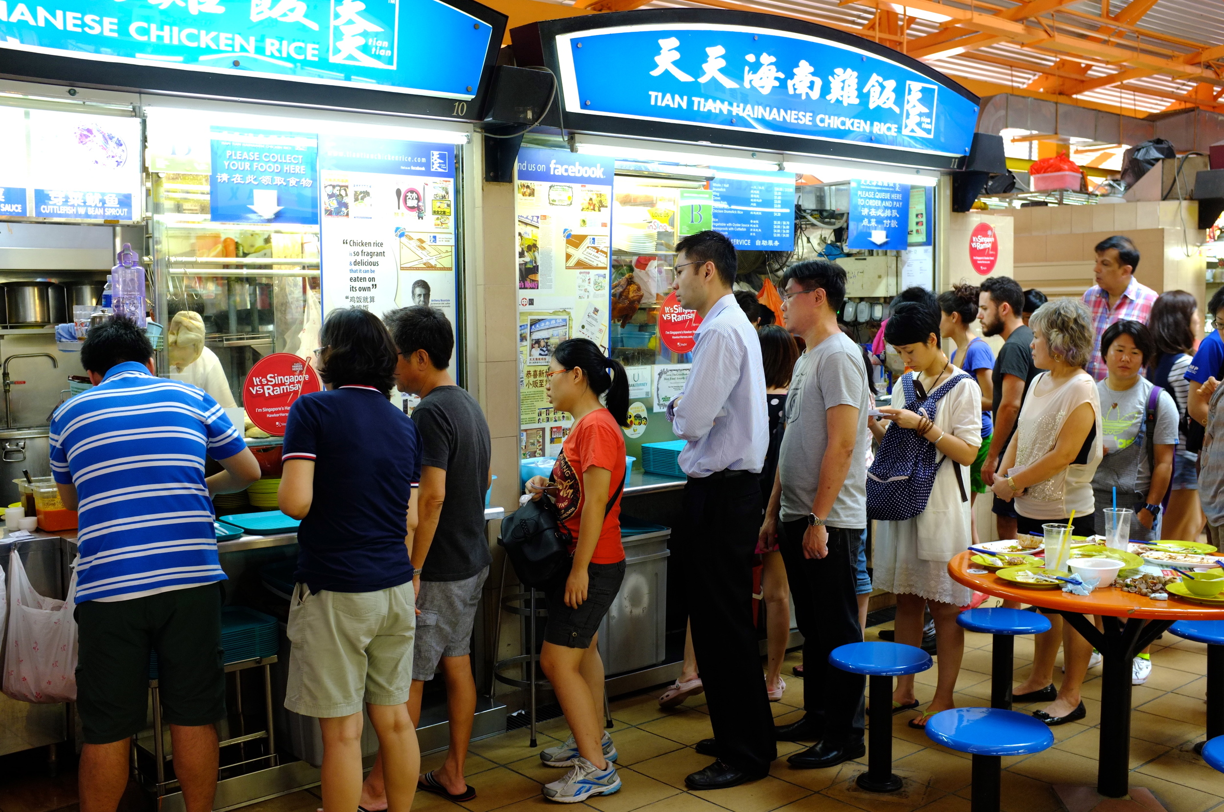People lining up for Hainanese chicken rice at Tian Tian in Maxwell Road Hawker Centre, Singapore