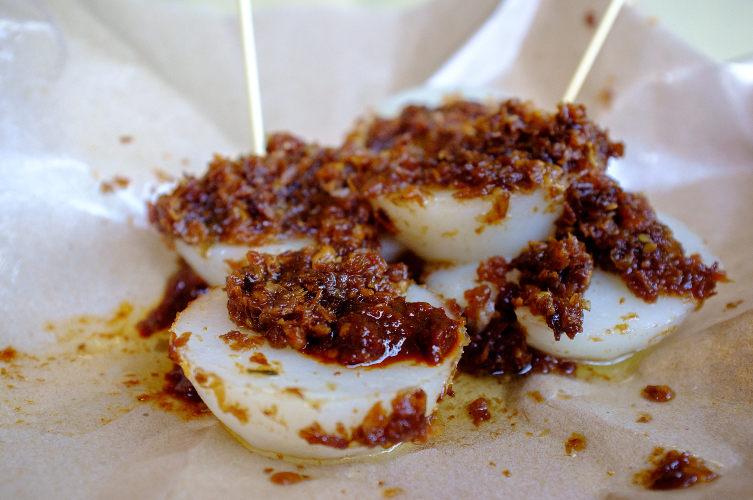Chwee kueh , a steamed rice cake topped with preserved radish, a popular breakfast item, costs less than $2 US