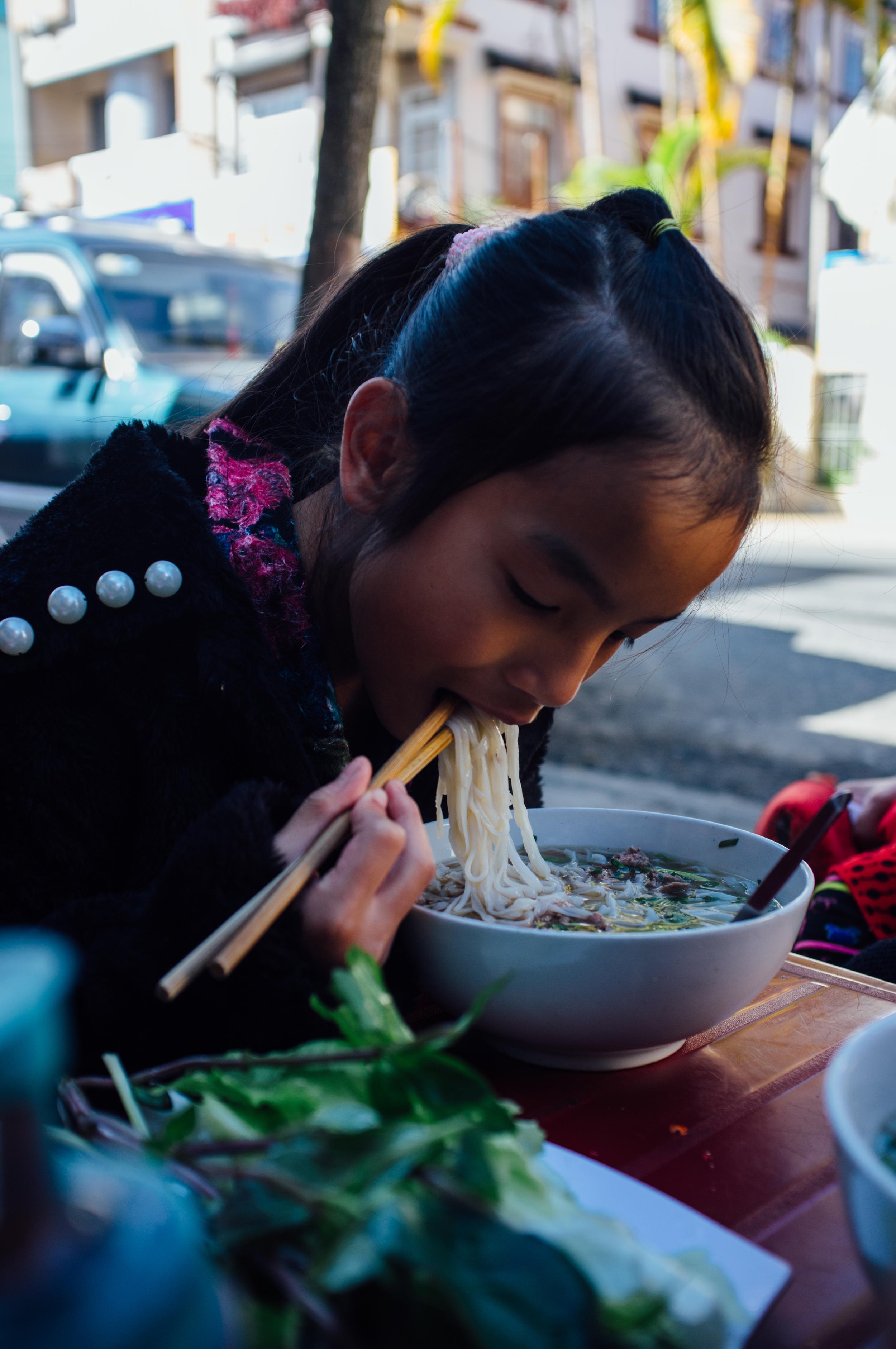 Dalat: A kid enjoying her morning  phở