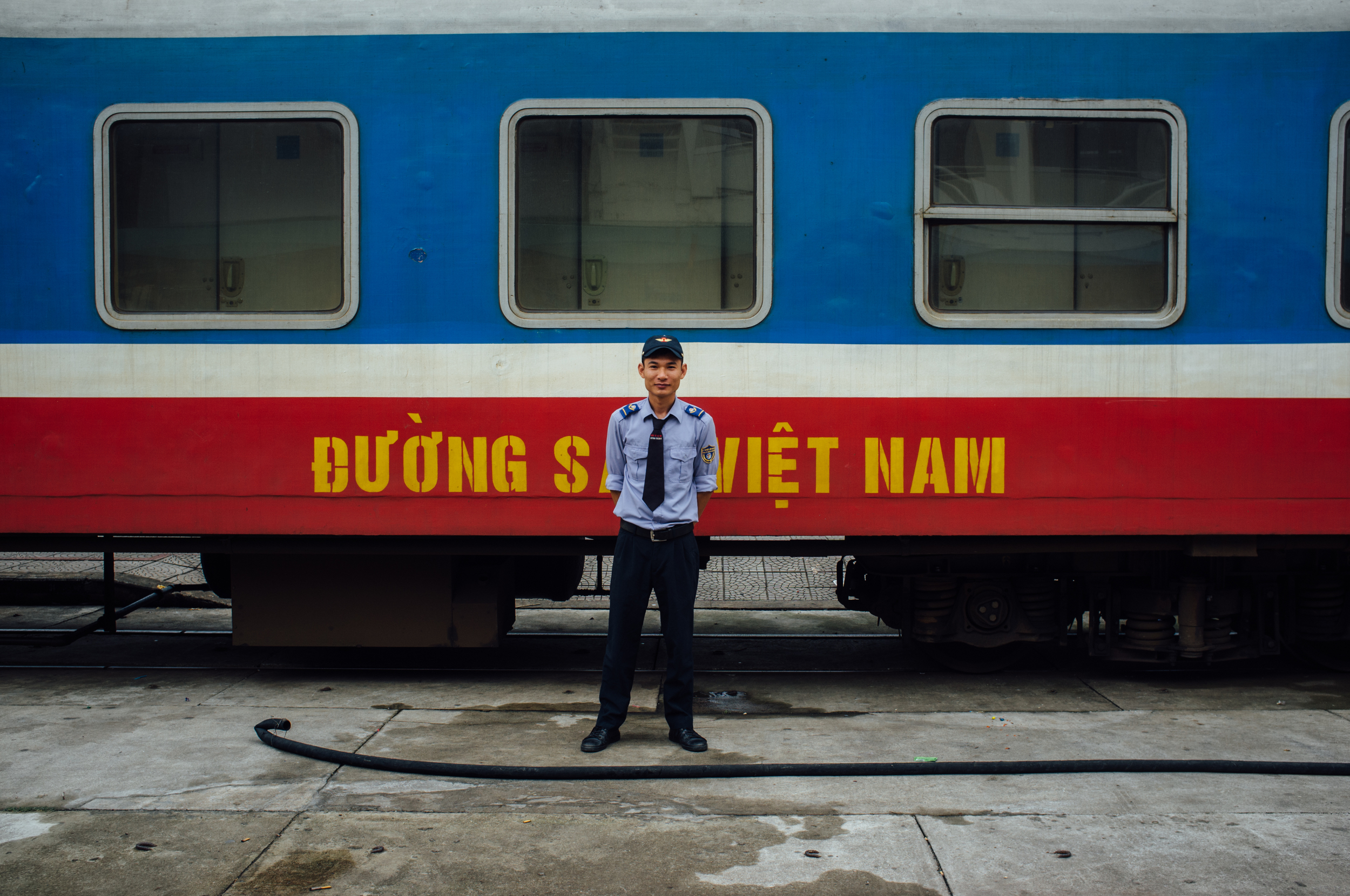 Vietnam Railways employee standing proud