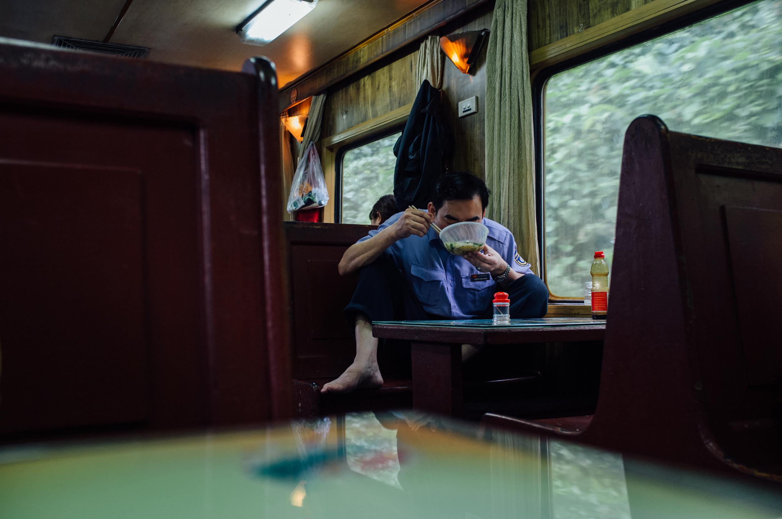 Vietnam Railway employee comfortably enjoying his own breakfast