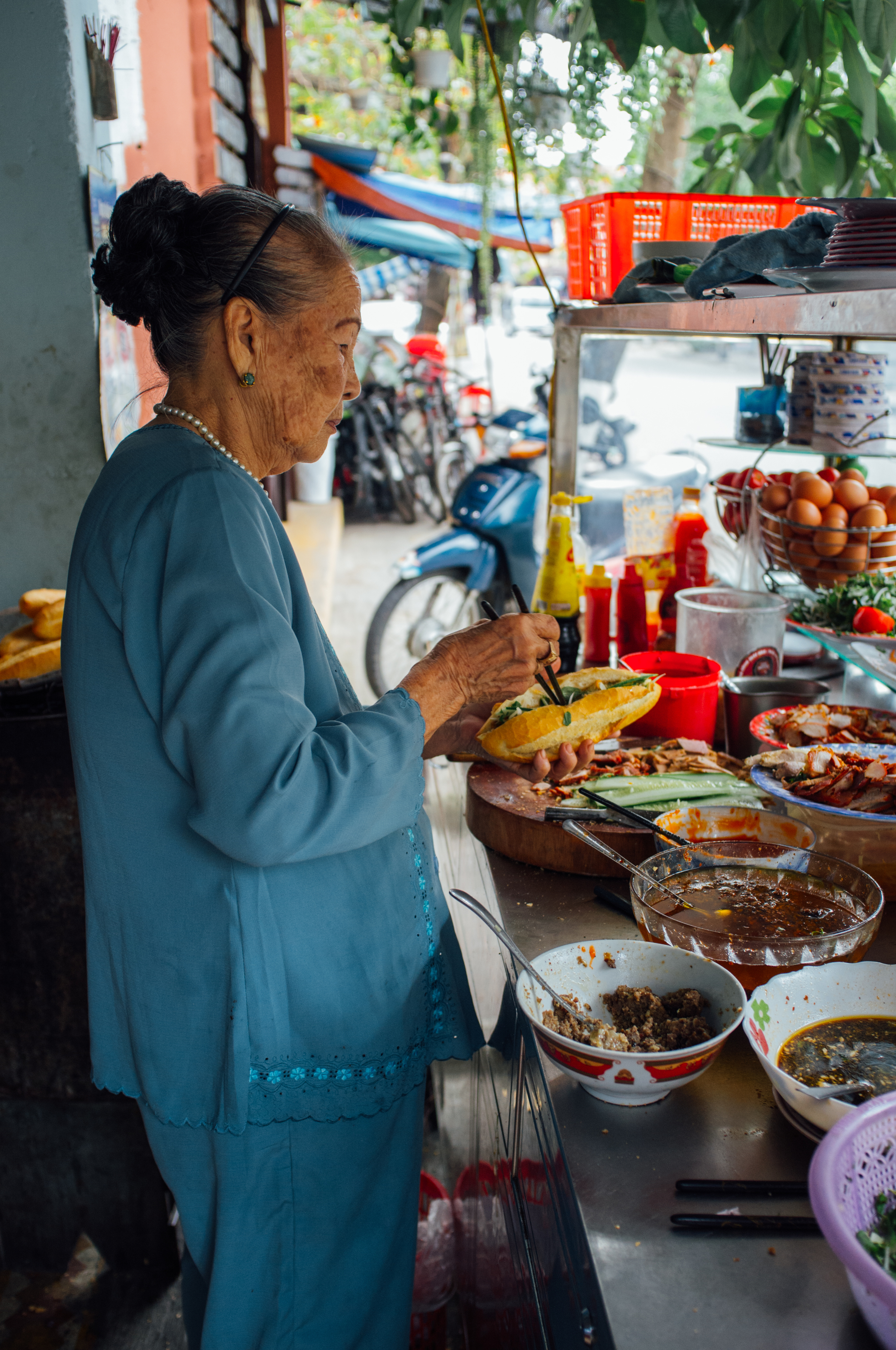 """The """"Bánh Mì Queen"""", around 85 years old, still presides over the shop every single day"""
