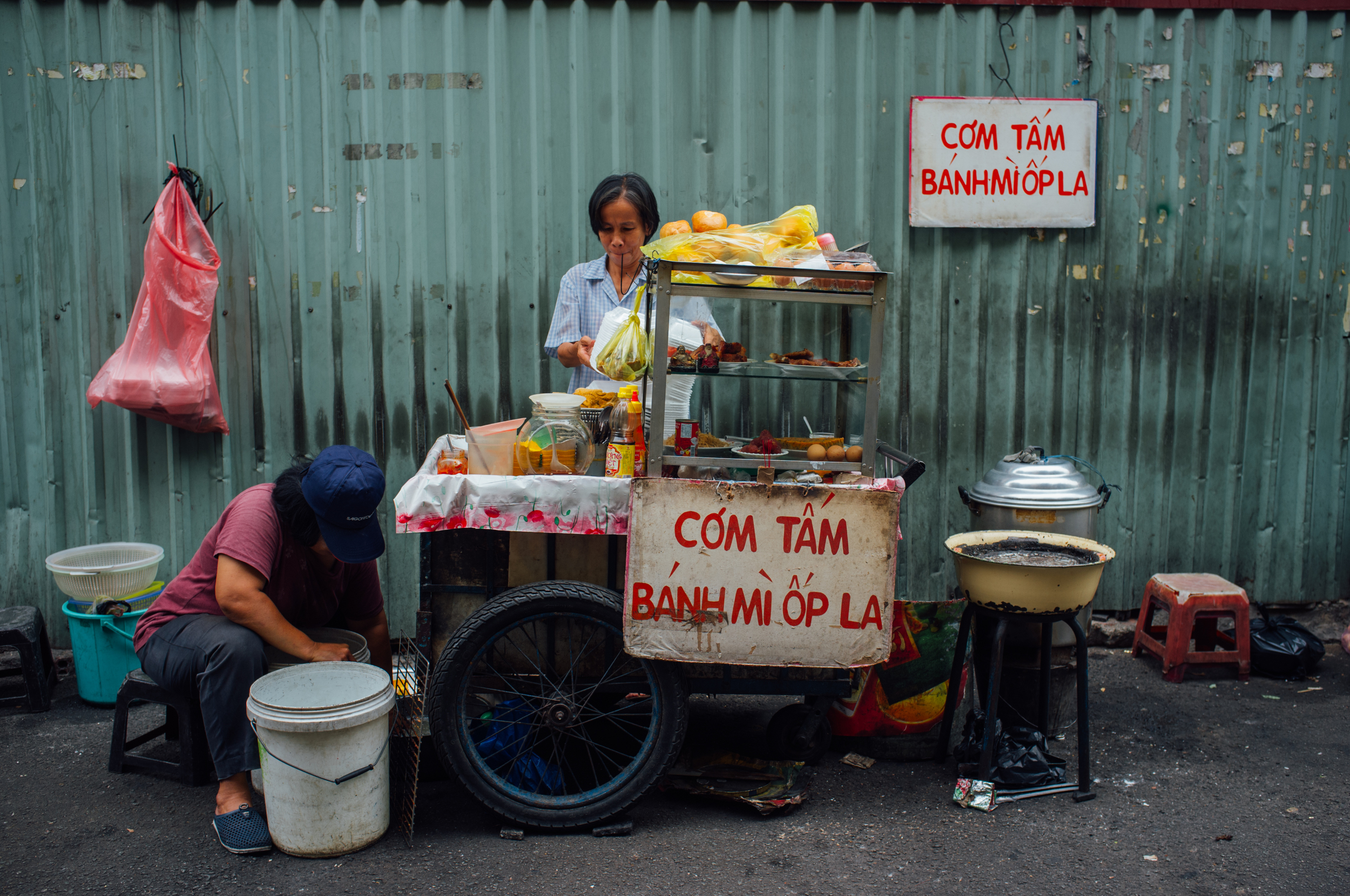 Vendor selling broken rice (cơm tấm) and fried egg sandwich (bánh mì ốp la)