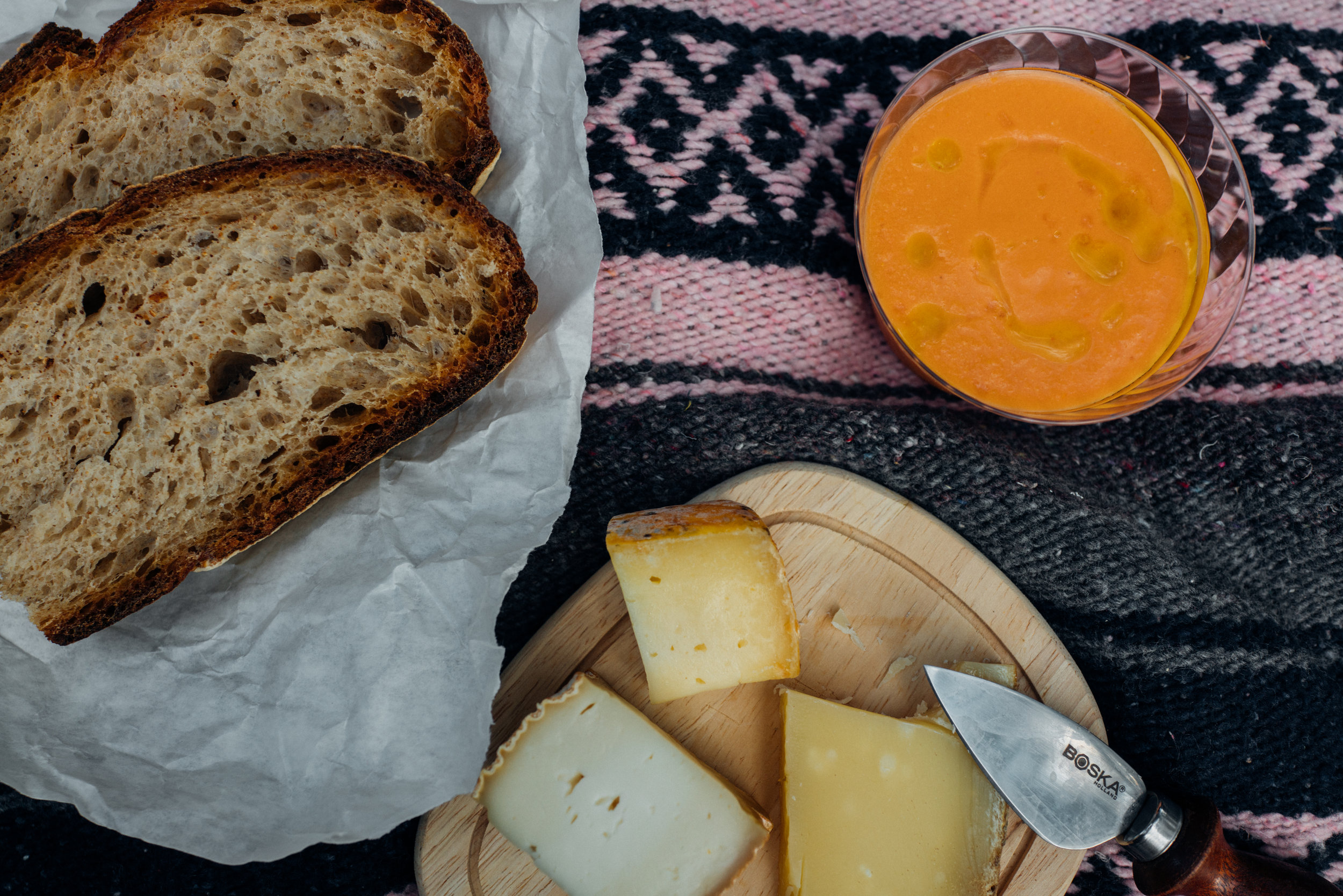 Picnic of gazpacho, sourdough bread and cheeses