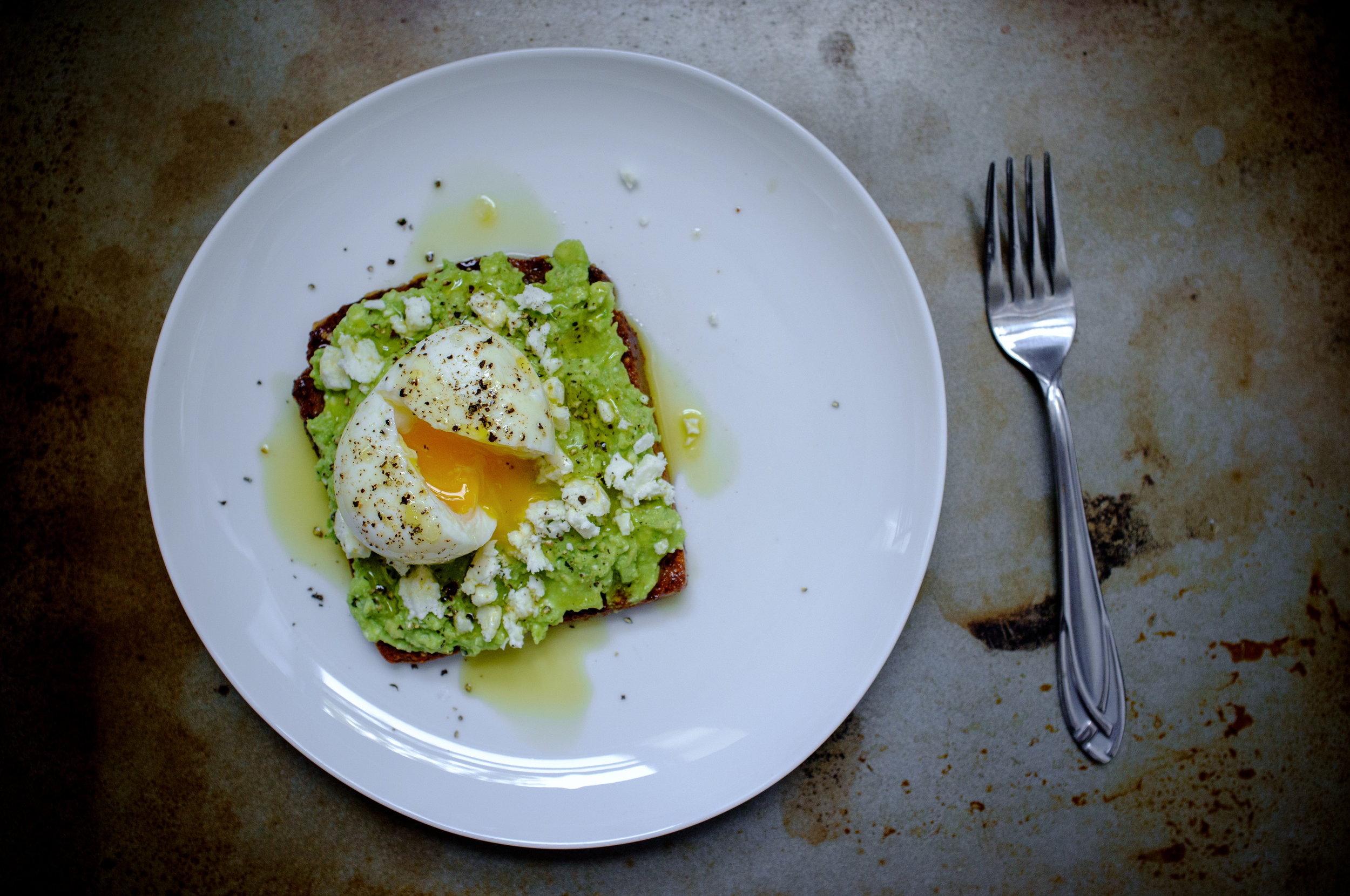 Avocado toast with feta cheese and a soft boiled egg
