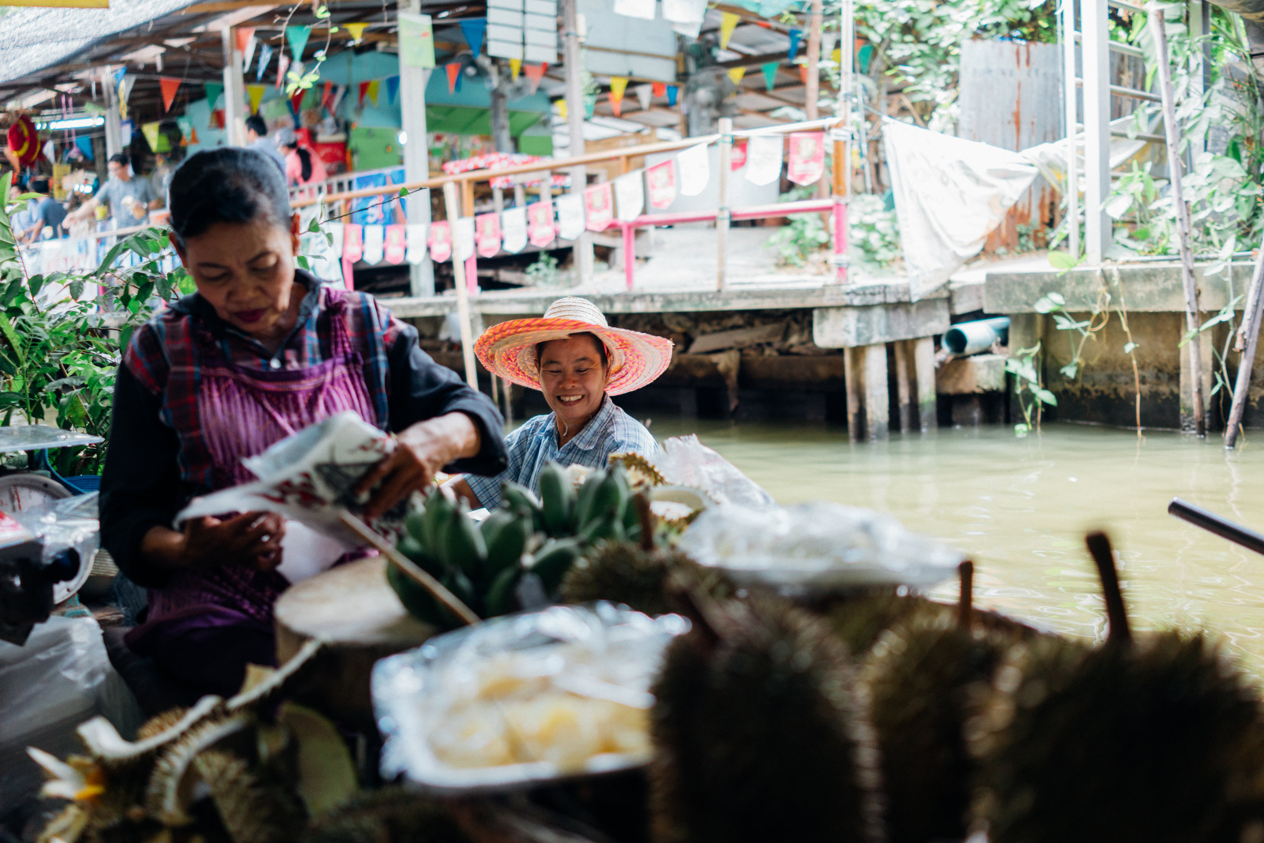 It's easy to forget, but canals used to be Bangkok's roads; most of these have been replaced by highways. Here are vendors at Khlong Lat Mayom Floating Market.