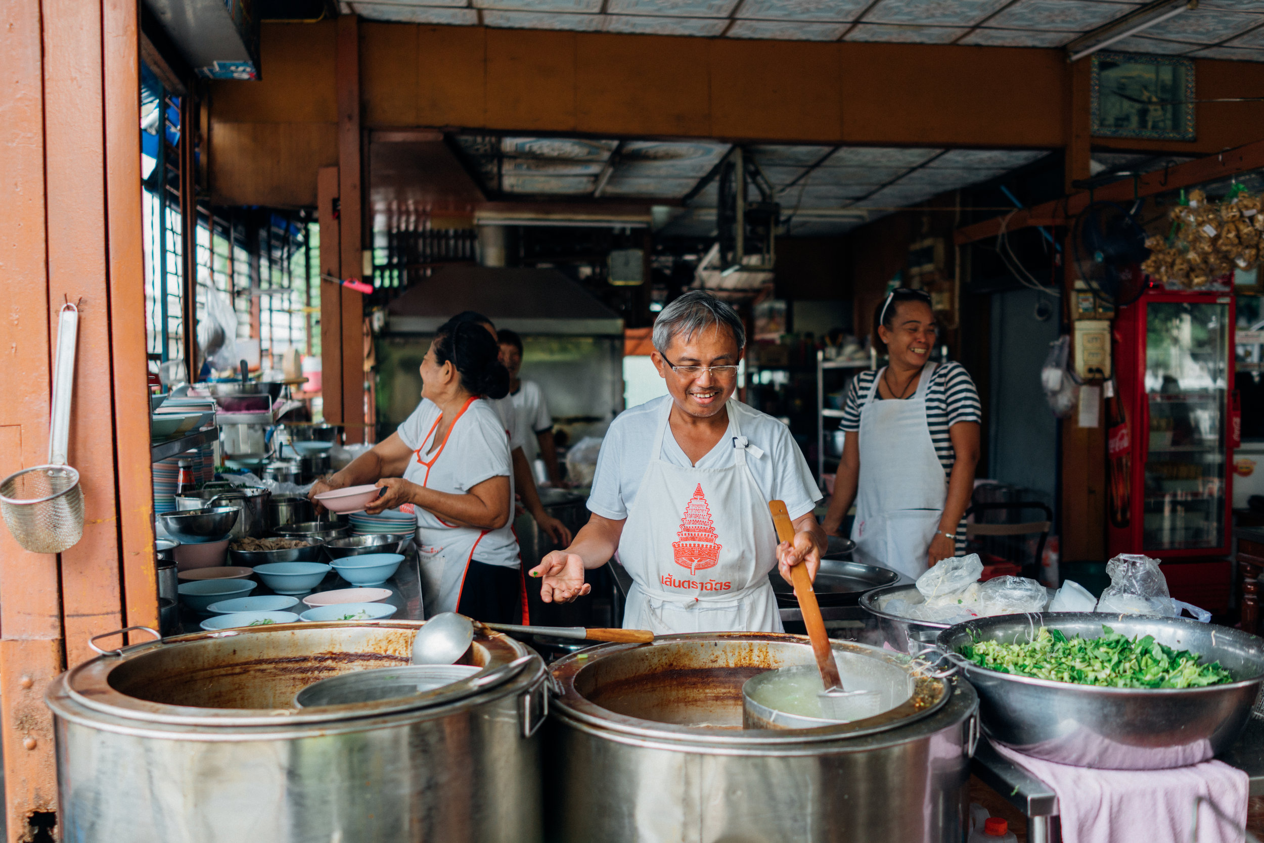 Happy boat noodle vendors in Bangkok