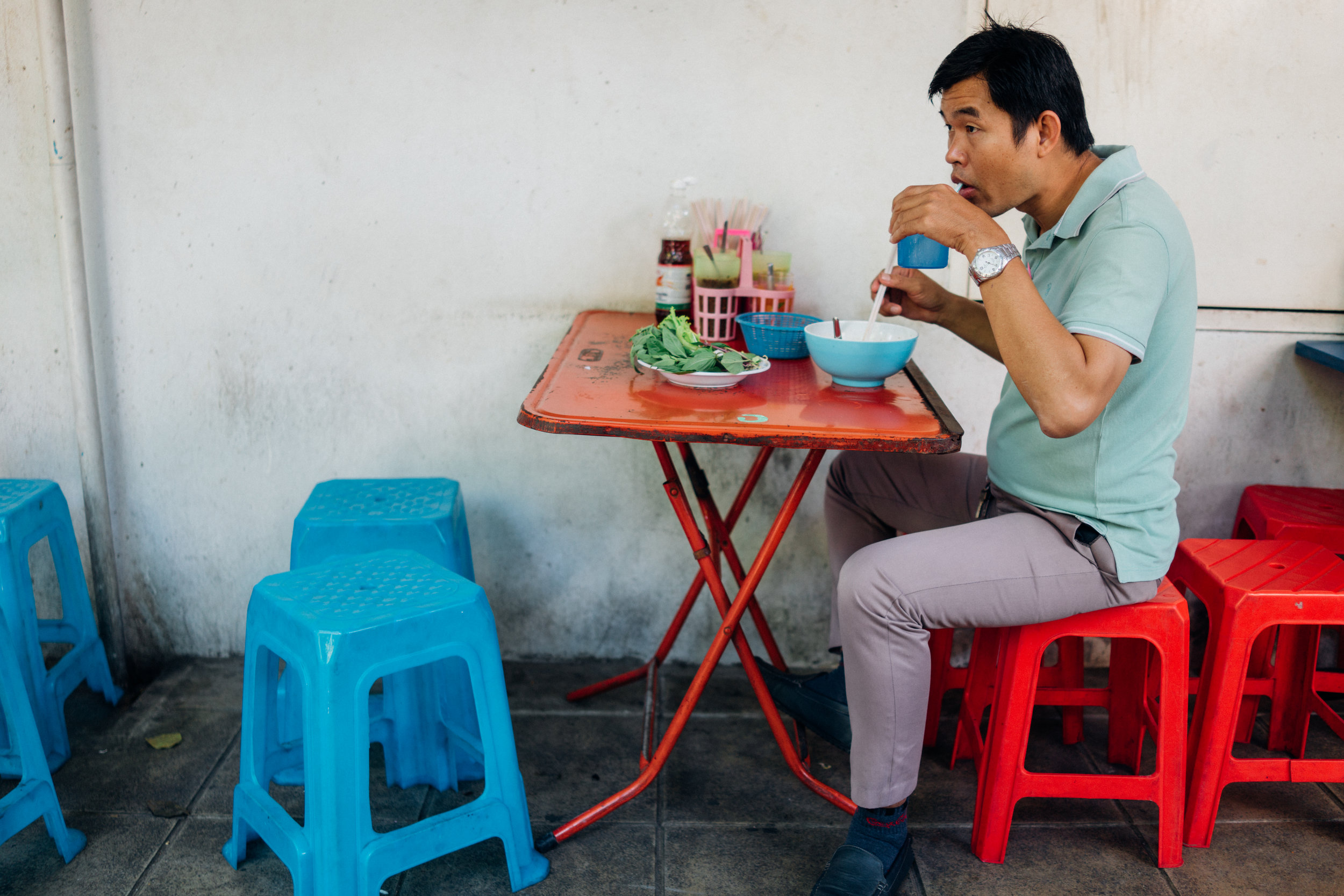 Colorful plastic stools equate to street food