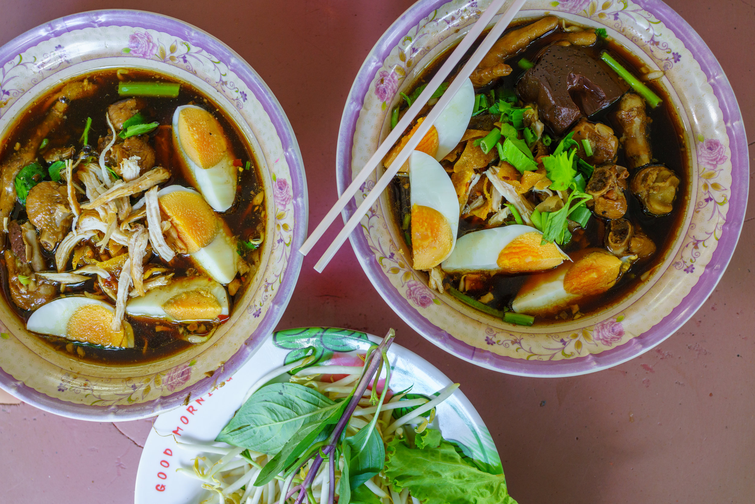 Kuay teow gai , chicken soup, for lunch at a street vendor in Bangkok