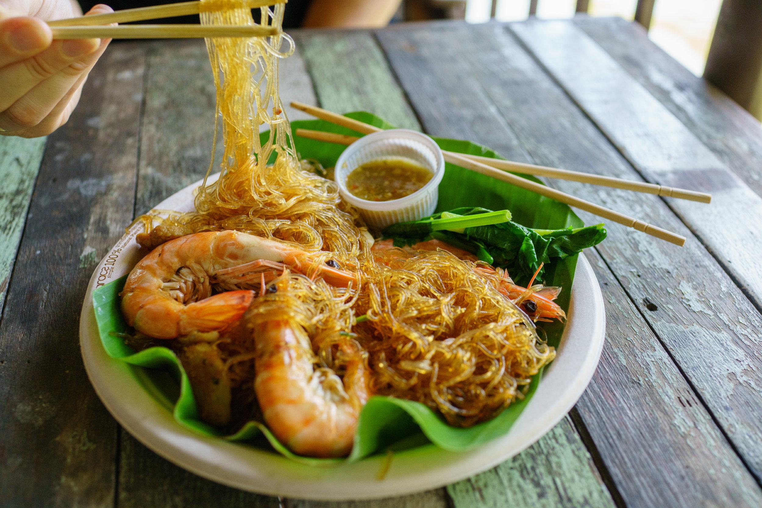 Enjoying   goong ob woon sen , a dish of glass noodles with shrimp