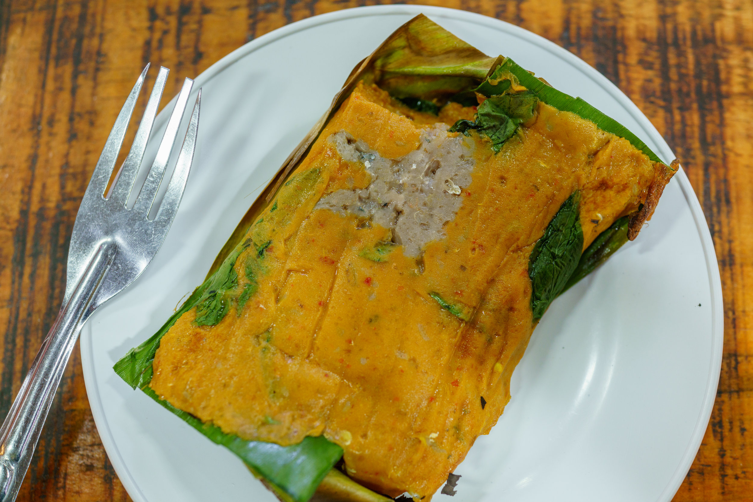 Fish blended with coconut milk and spices and then steamed to make  hor mok